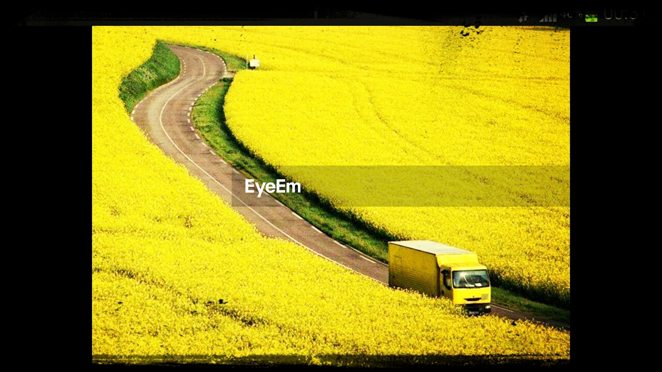 yellow, transfer print, auto post production filter, transportation, high angle view, road, built structure, outdoors, street, architecture, no people, road marking, day, building exterior, sunlight, car, travel, mode of transport, field, landscape