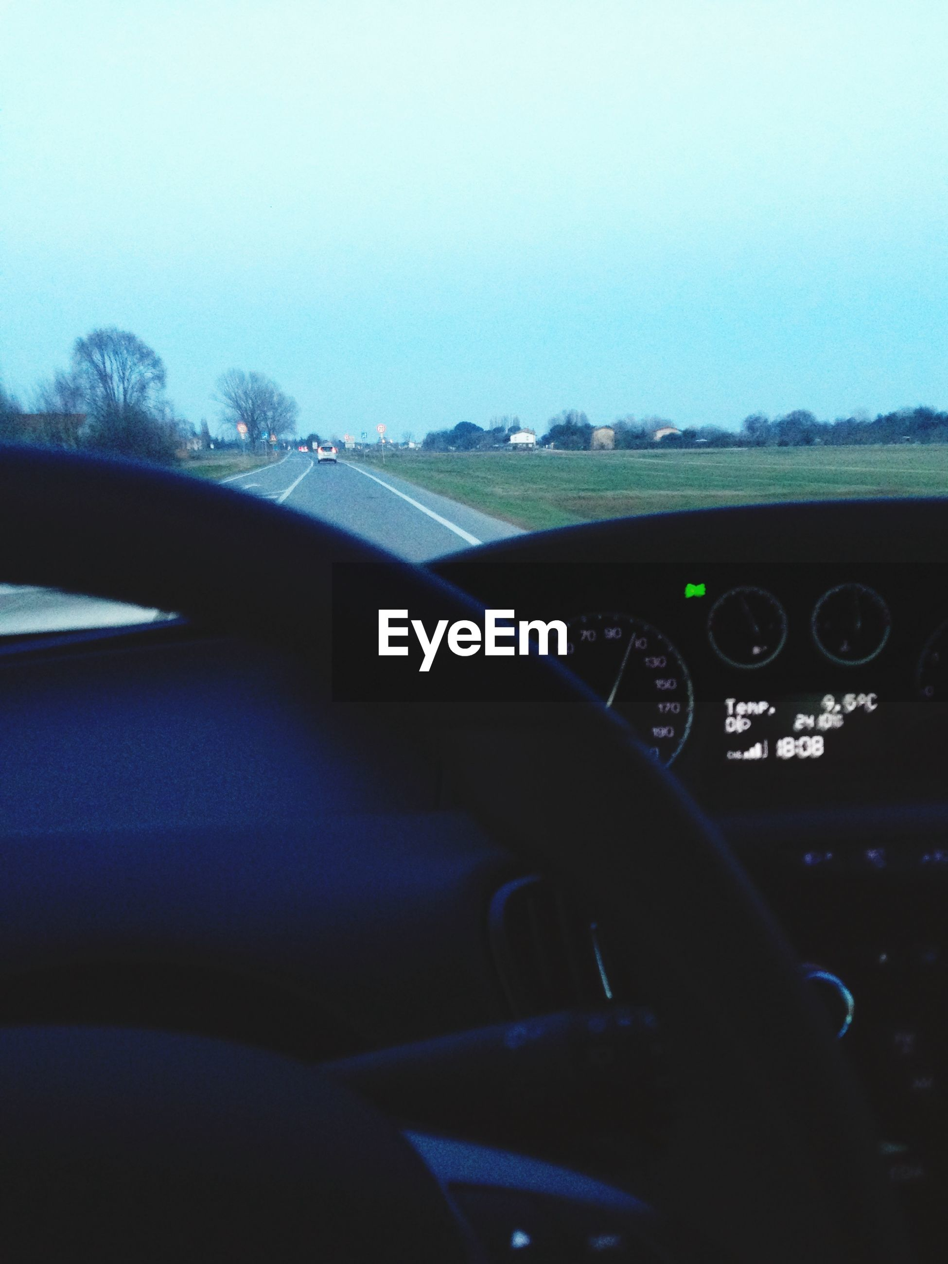 transportation, mode of transport, land vehicle, car, car interior, vehicle interior, part of, windshield, cropped, travel, road, dashboard, journey, driving, steering wheel, side-view mirror, on the move, close-up, clear sky, road trip