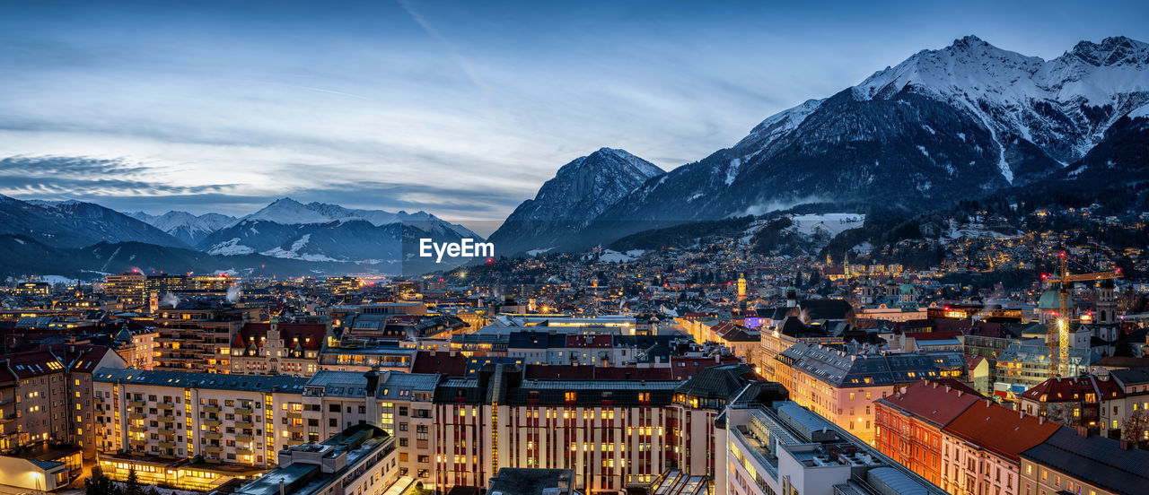 Aerial view of townscape against sky during winter