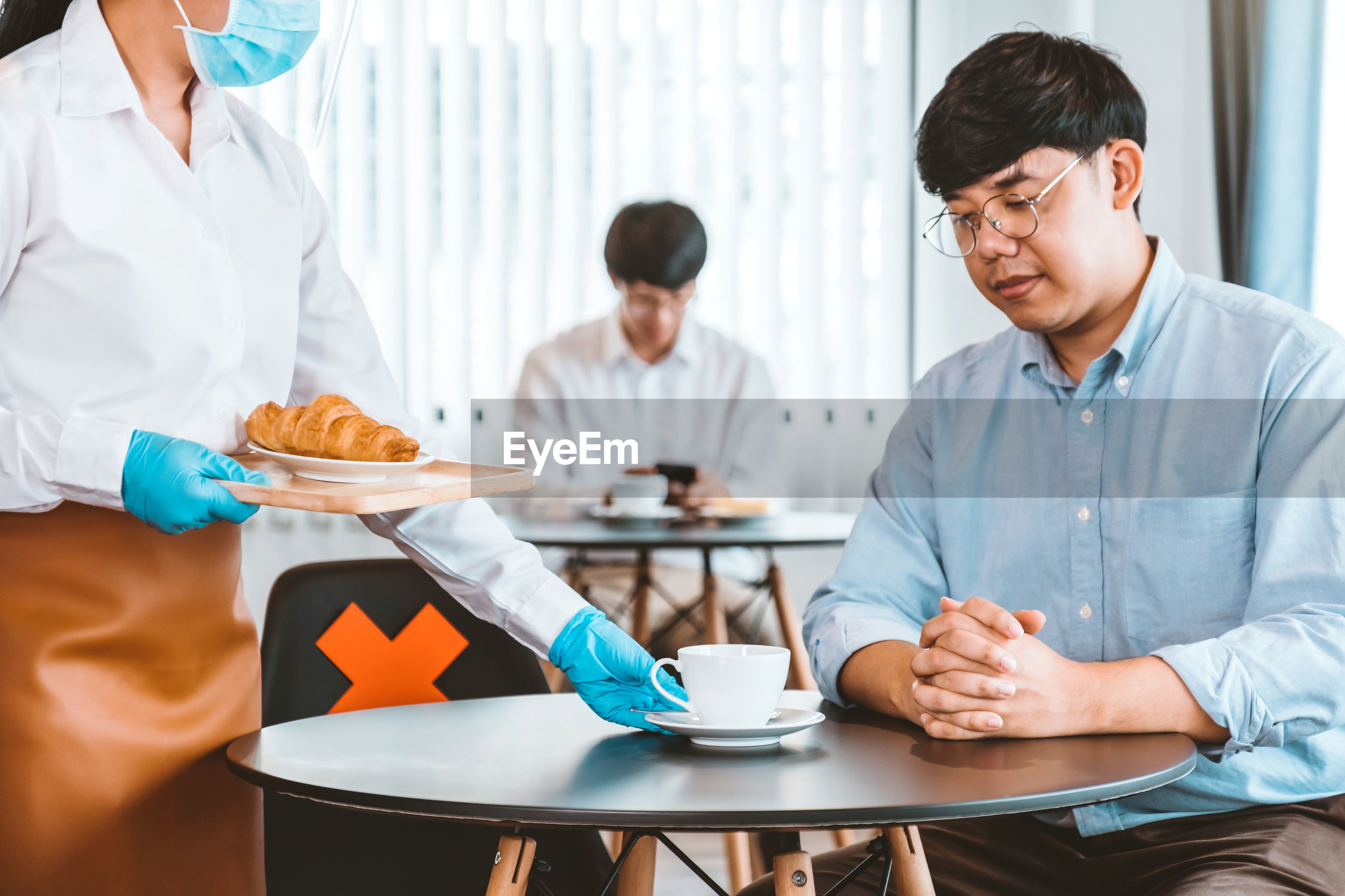 PEOPLE WORKING WITH COFFEE IN CUP