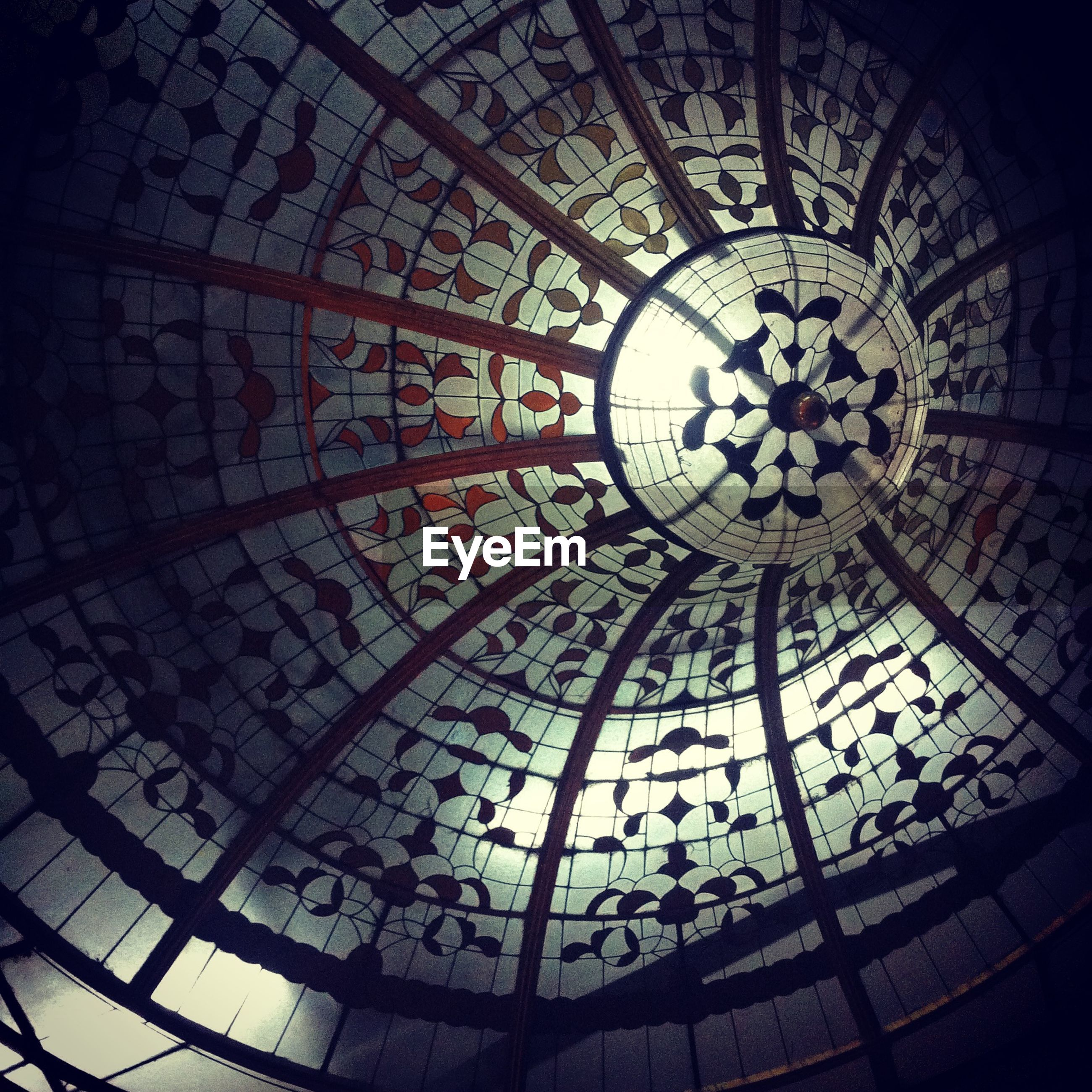 low angle view, indoors, ceiling, architecture, built structure, pattern, circle, design, geometric shape, architectural feature, directly below, religion, art and craft, ornate, no people, clock, dome, church, place of worship, art