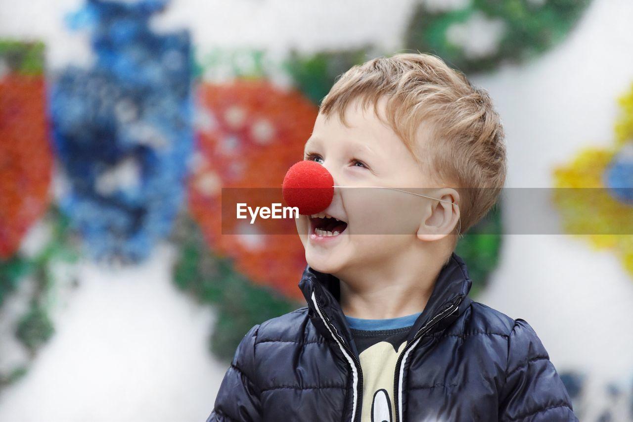 Cute boy wearing clowns nose