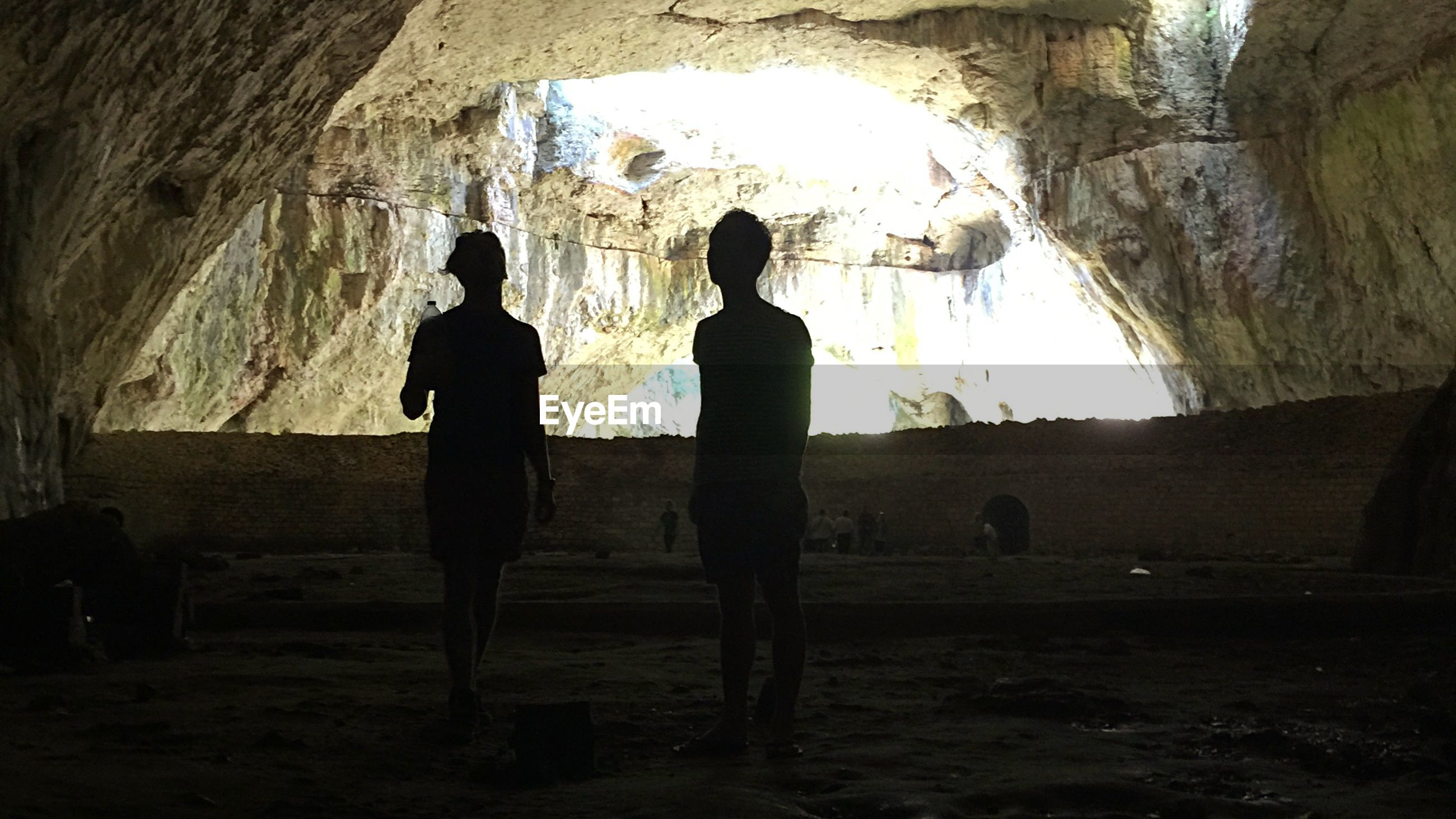 silhouette, real people, indoors, two people, full length, arch, cave, leisure activity, men, togetherness, day, women, people