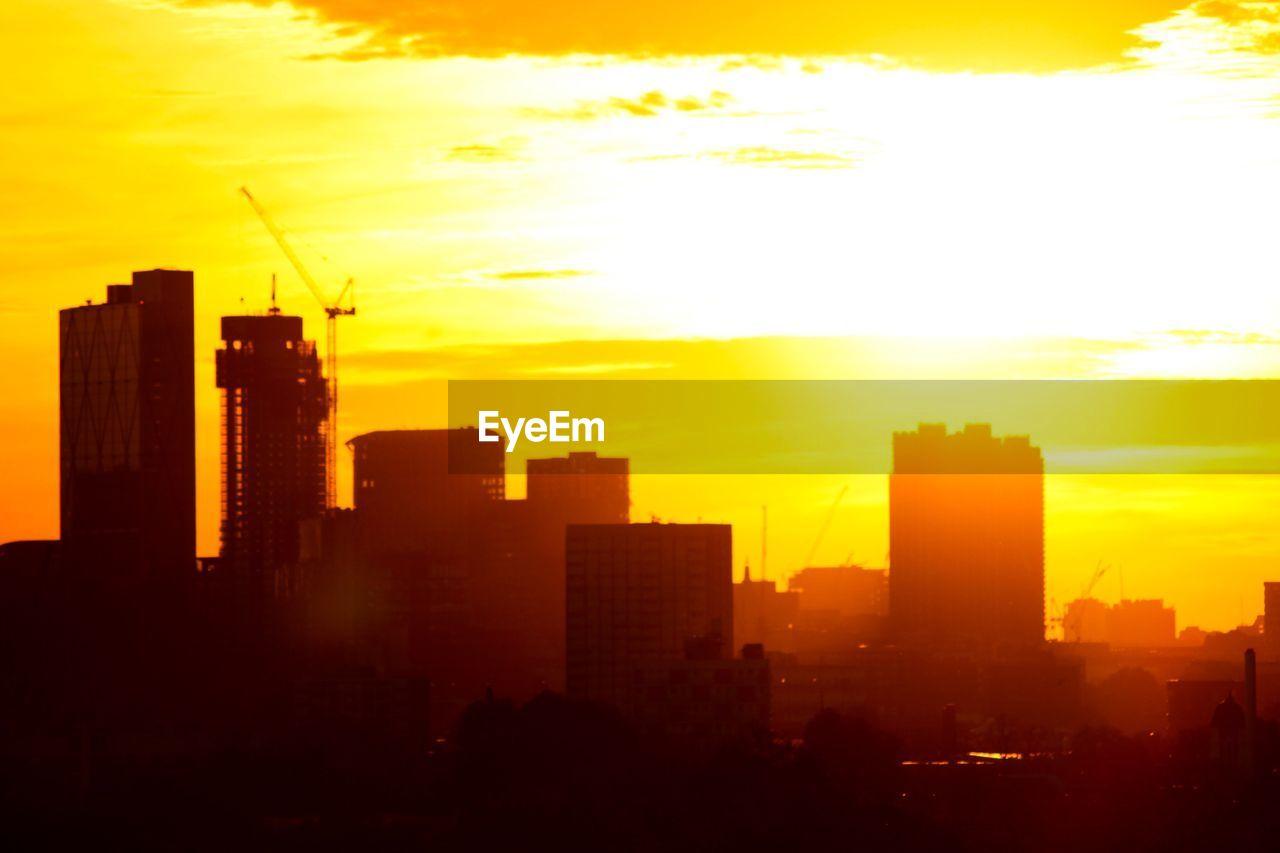 sunset, skyscraper, architecture, city, building exterior, cityscape, development, orange color, modern, silhouette, built structure, sun, skyline, sky, no people, city life, growth, urban skyline, outdoors