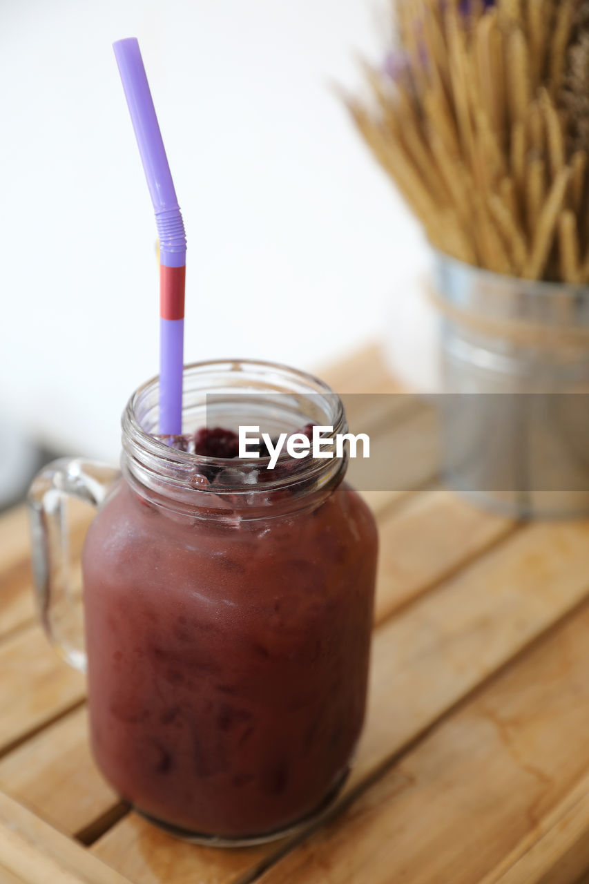 container, food and drink, drinking straw, straw, food, jar, freshness, refreshment, table, drink, indoors, glass - material, close-up, healthy eating, still life, no people, wood - material, wellbeing, focus on foreground, smoothie, glass, temptation