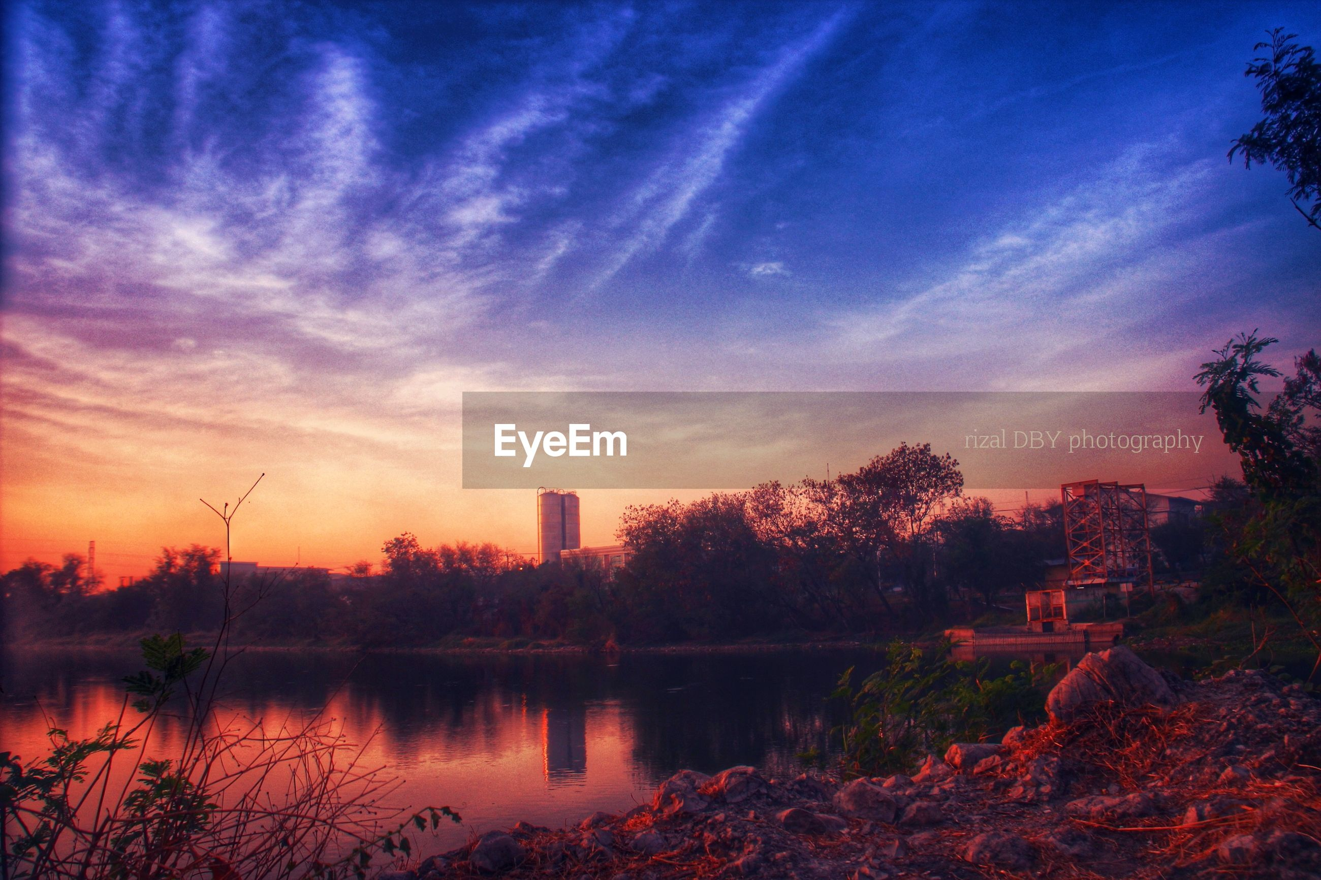 sunset, sky, tree, water, architecture, built structure, building exterior, reflection, lake, river, silhouette, scenics, cloud - sky, tranquility, beauty in nature, tranquil scene, waterfront, orange color, nature, cloud