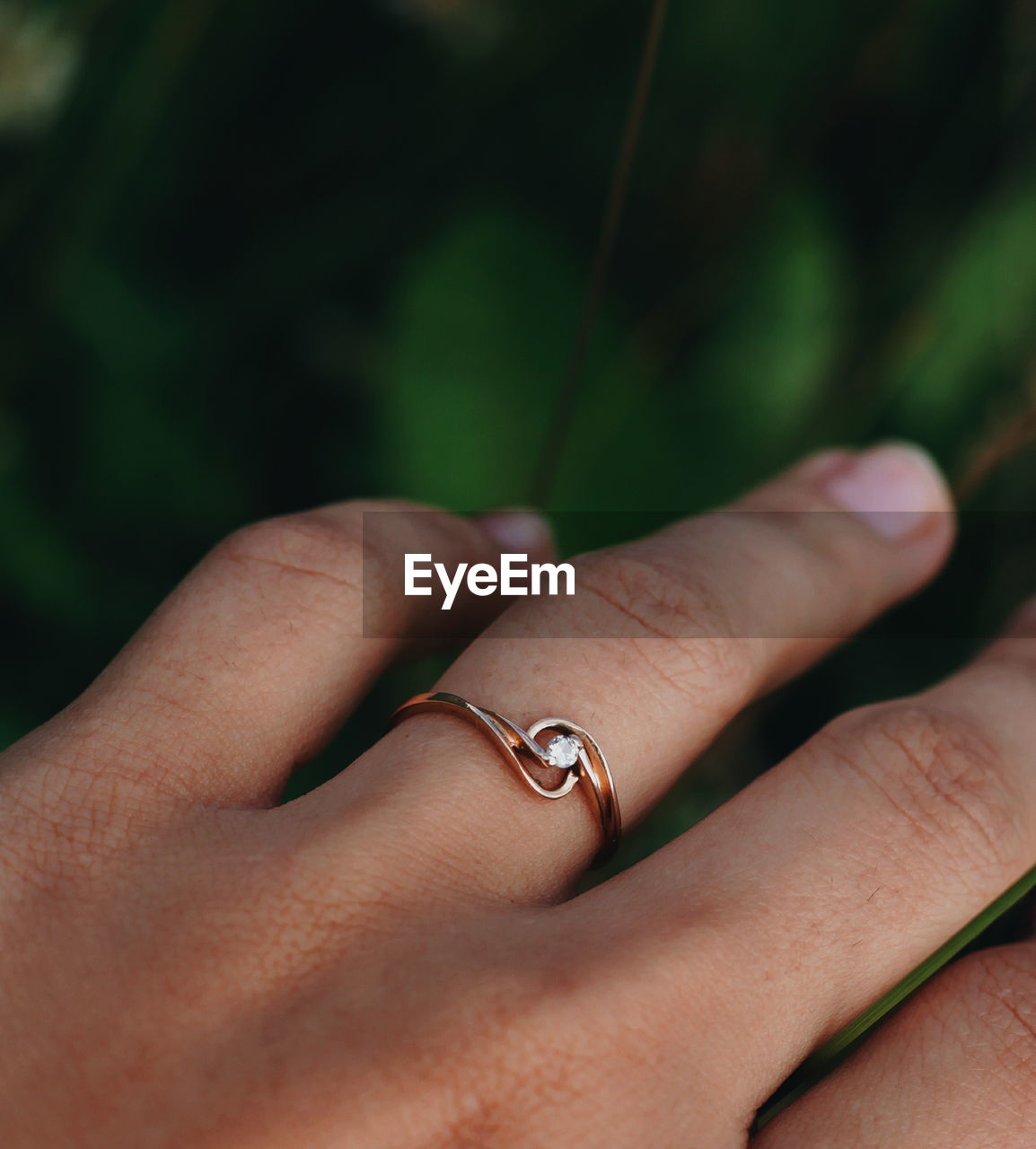 Close-up of woman hand wearing engagement ring