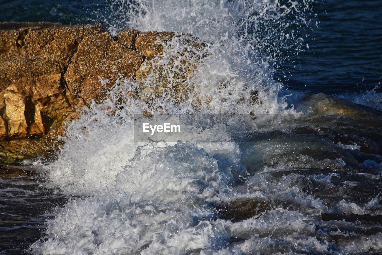 water, motion, splashing, sea, rock, wave, power in nature, sport, nature, solid, beauty in nature, power, rock - object, breaking, no people, aquatic sport, blurred motion, day, outdoors, flowing water, hitting, flowing