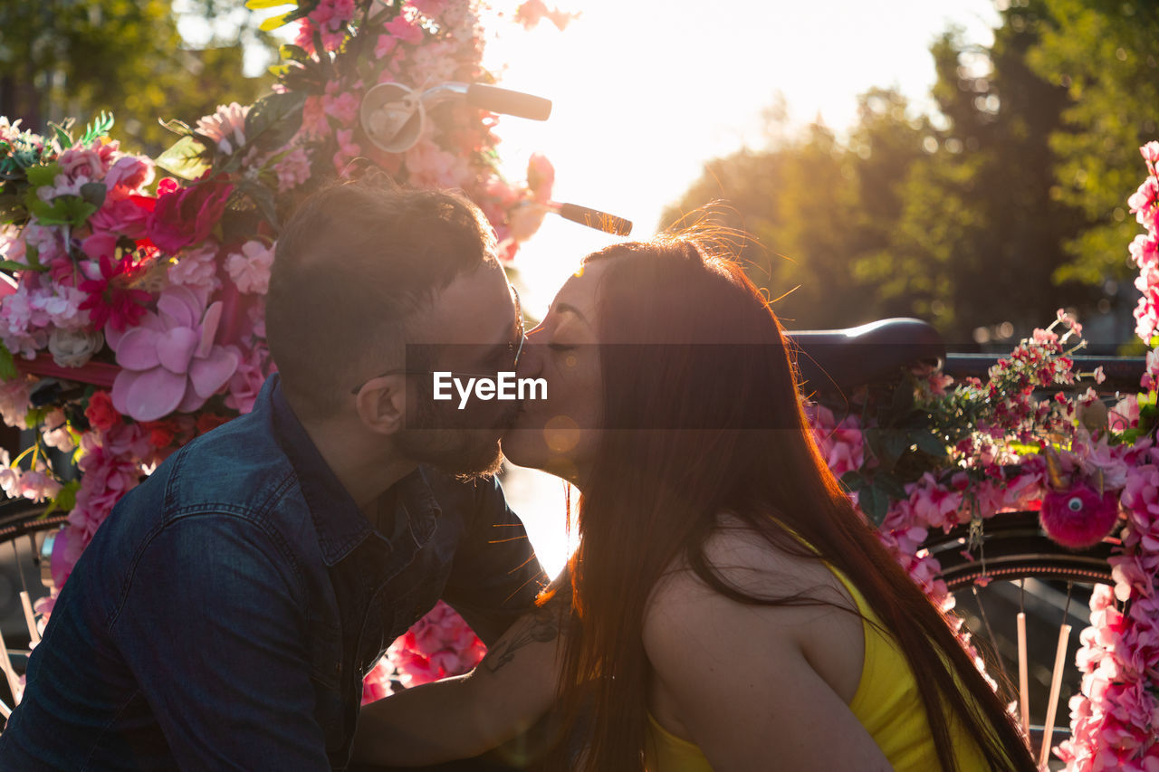 two people, real people, togetherness, plant, nature, emotion, love, women, young women, flower, bonding, adult, lifestyles, flowering plant, young adult, couple - relationship, sunlight, leisure activity, men, positive emotion, outdoors