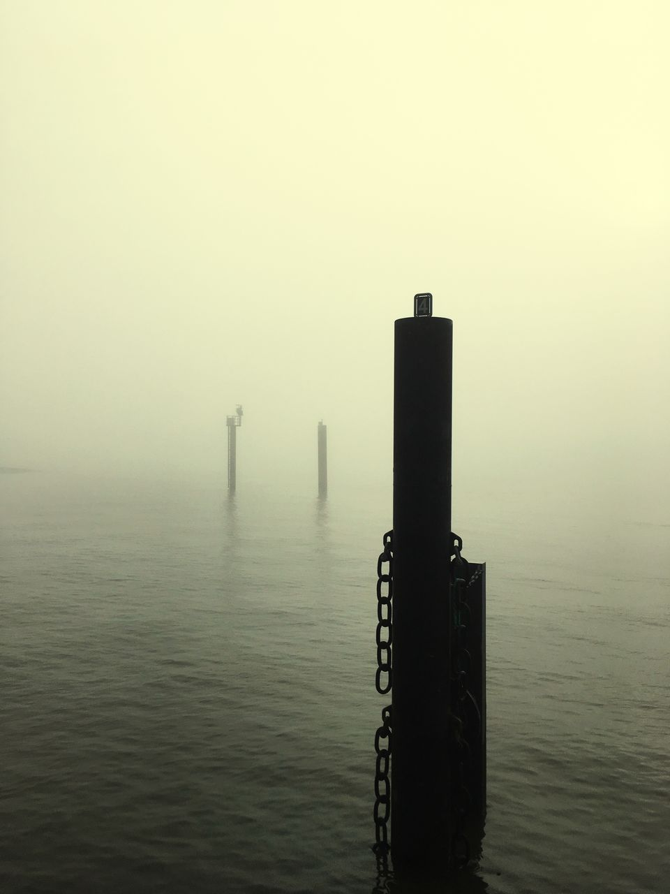 water, waterfront, fog, post, no people, sea, nature, wooden post, sky, tranquility, beauty in nature, tranquil scene, scenics - nature, wood - material, architecture, copy space, built structure, outdoors, hazy