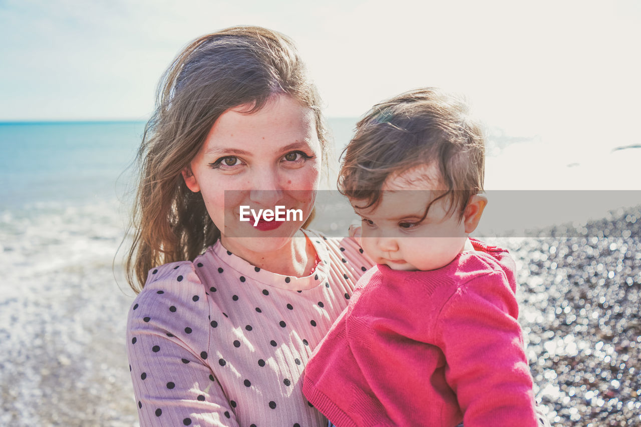 Portrait of mother and daughter at beach