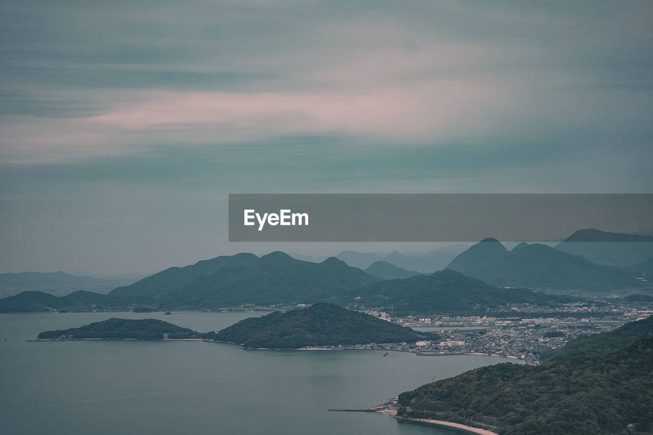 sky, mountain, scenics - nature, cloud - sky, beauty in nature, water, tranquility, tranquil scene, mountain range, no people, nature, sunset, idyllic, non-urban scene, waterfront, outdoors, sea, remote