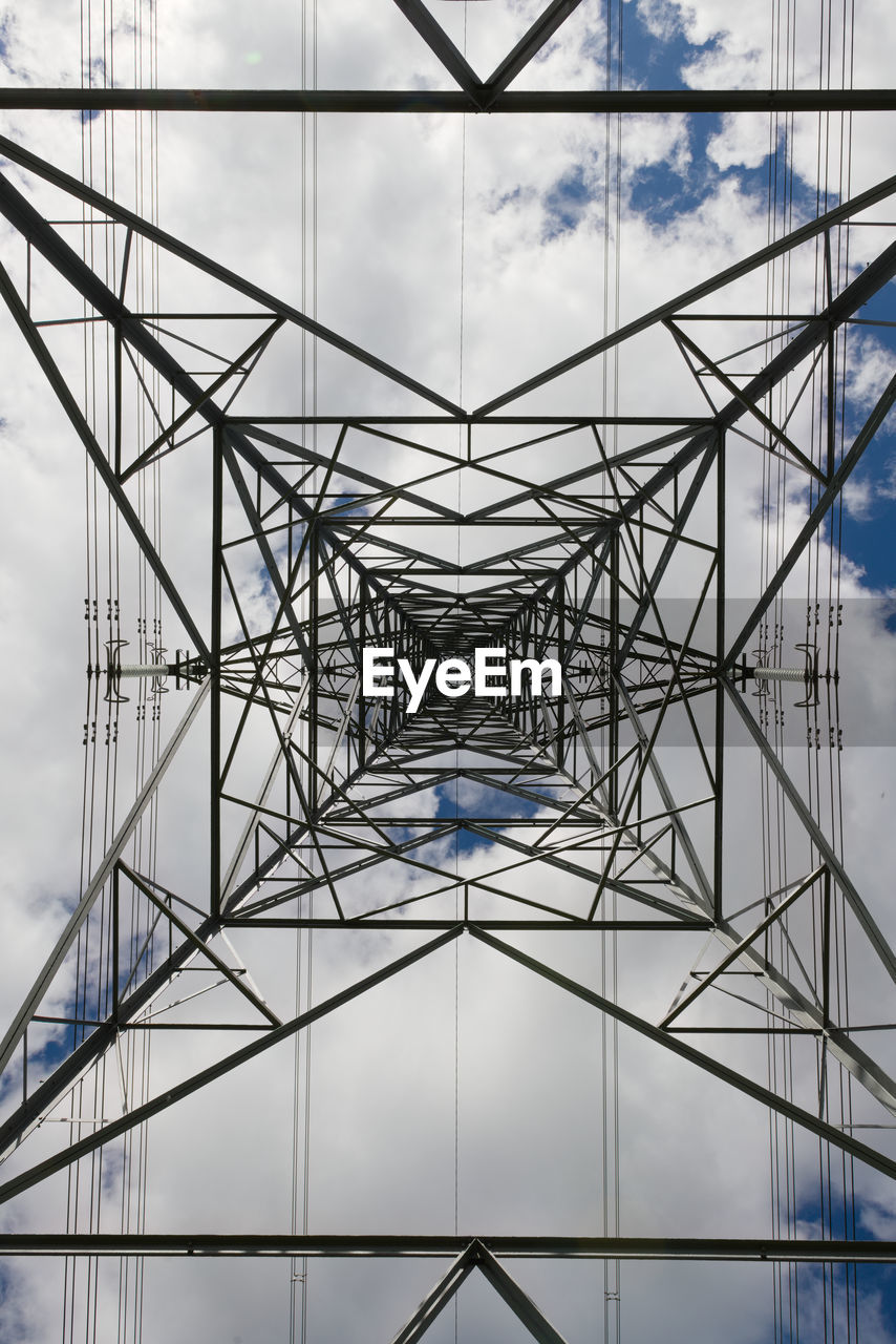 Abstract background texture image of power transmission lines running behind pylon