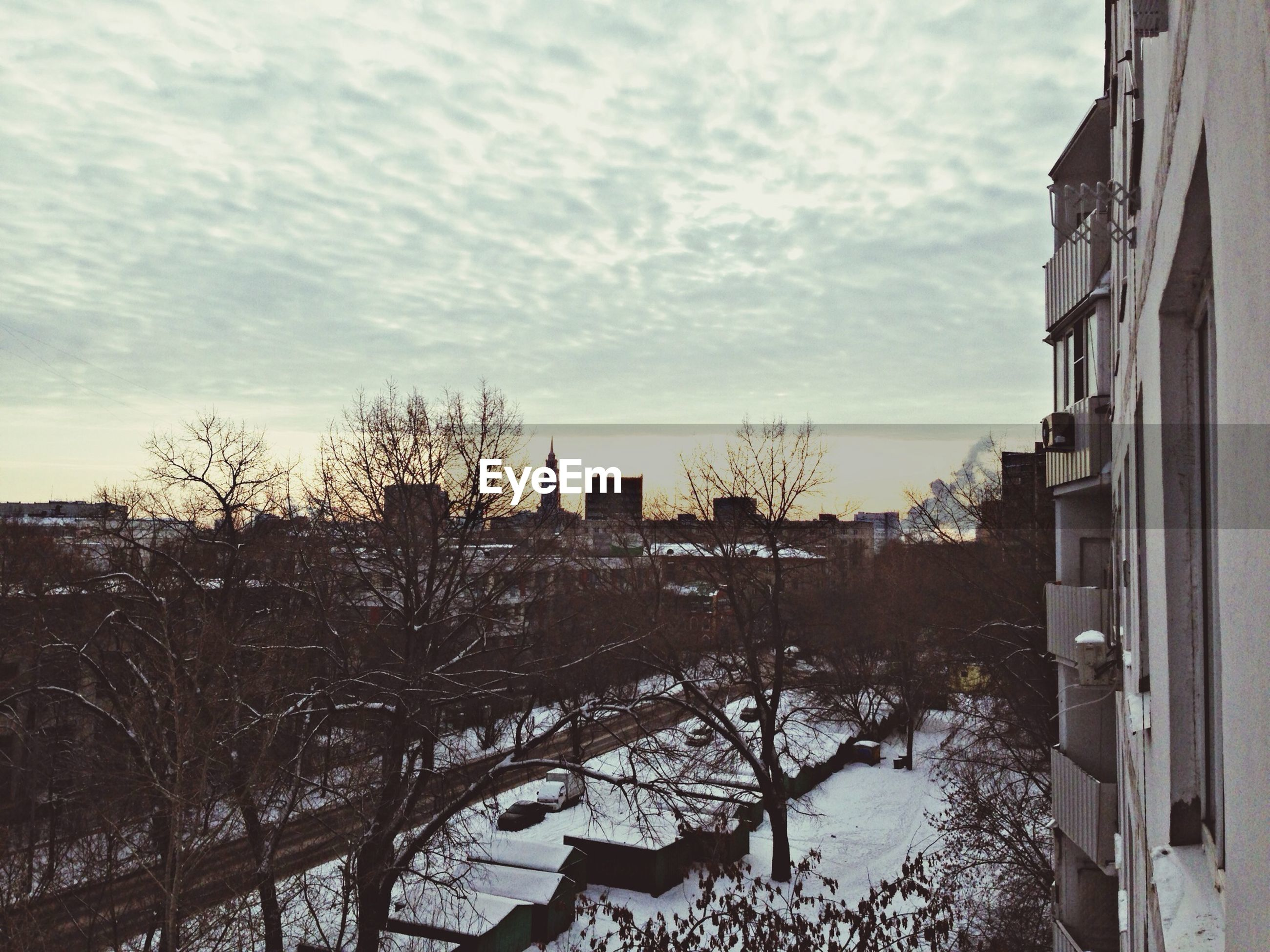building exterior, architecture, built structure, sky, cloud - sky, house, residential structure, tree, cloudy, bare tree, residential building, weather, snow, cloud, winter, cold temperature, city, nature, residential district, outdoors