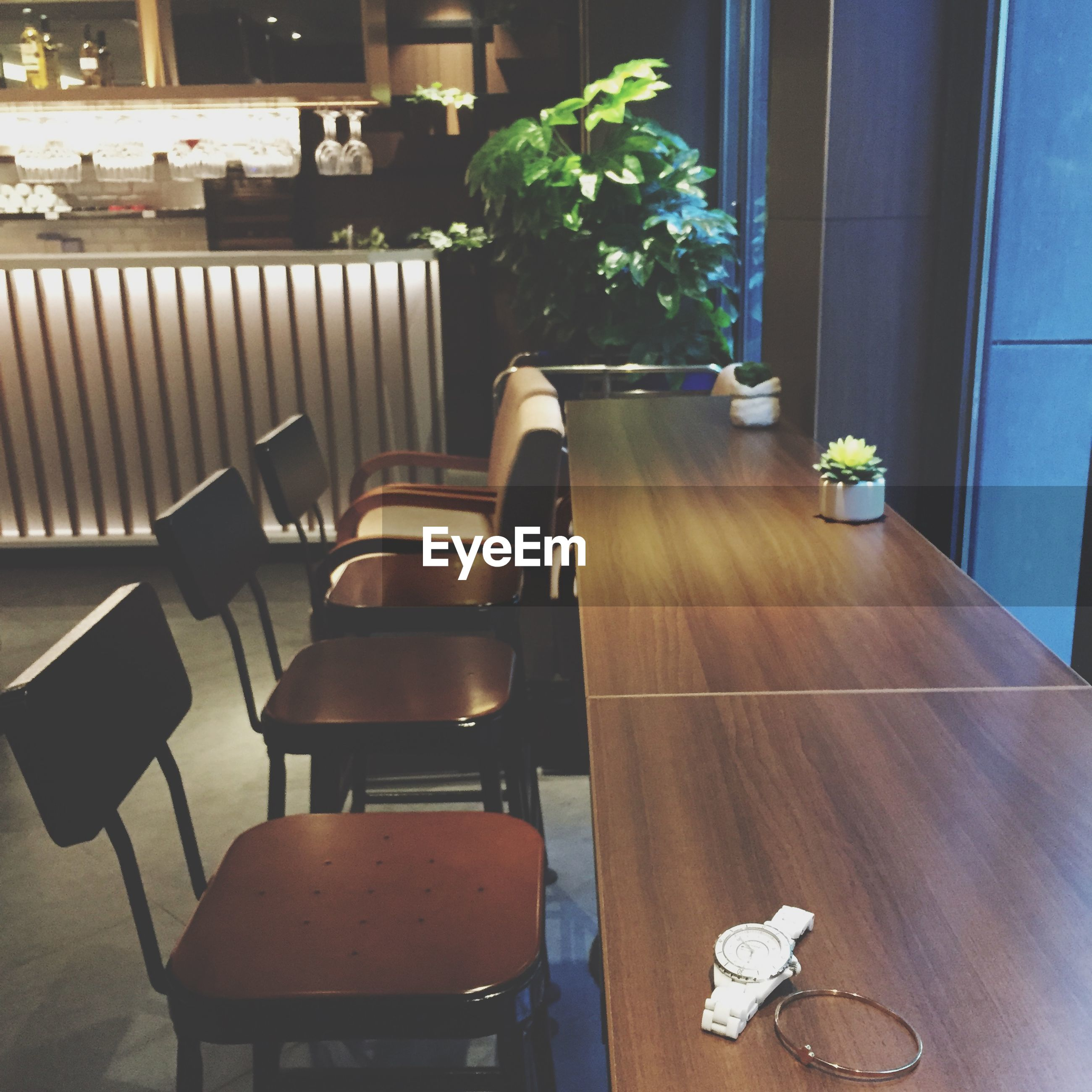 indoors, chair, table, absence, empty, furniture, home interior, sofa, seat, home showcase interior, living room, dining table, domestic room, vase, restaurant, relaxation, arrangement, place setting, no people, potted plant