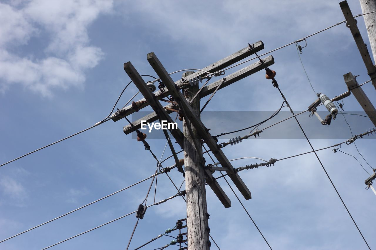 low angle view, cloud - sky, sky, cable, connection, day, nature, no people, electricity, power line, power supply, outdoors, technology, fuel and power generation, electricity pylon, metal, communication, complexity, damaged, telephone pole, telephone line, electrical equipment