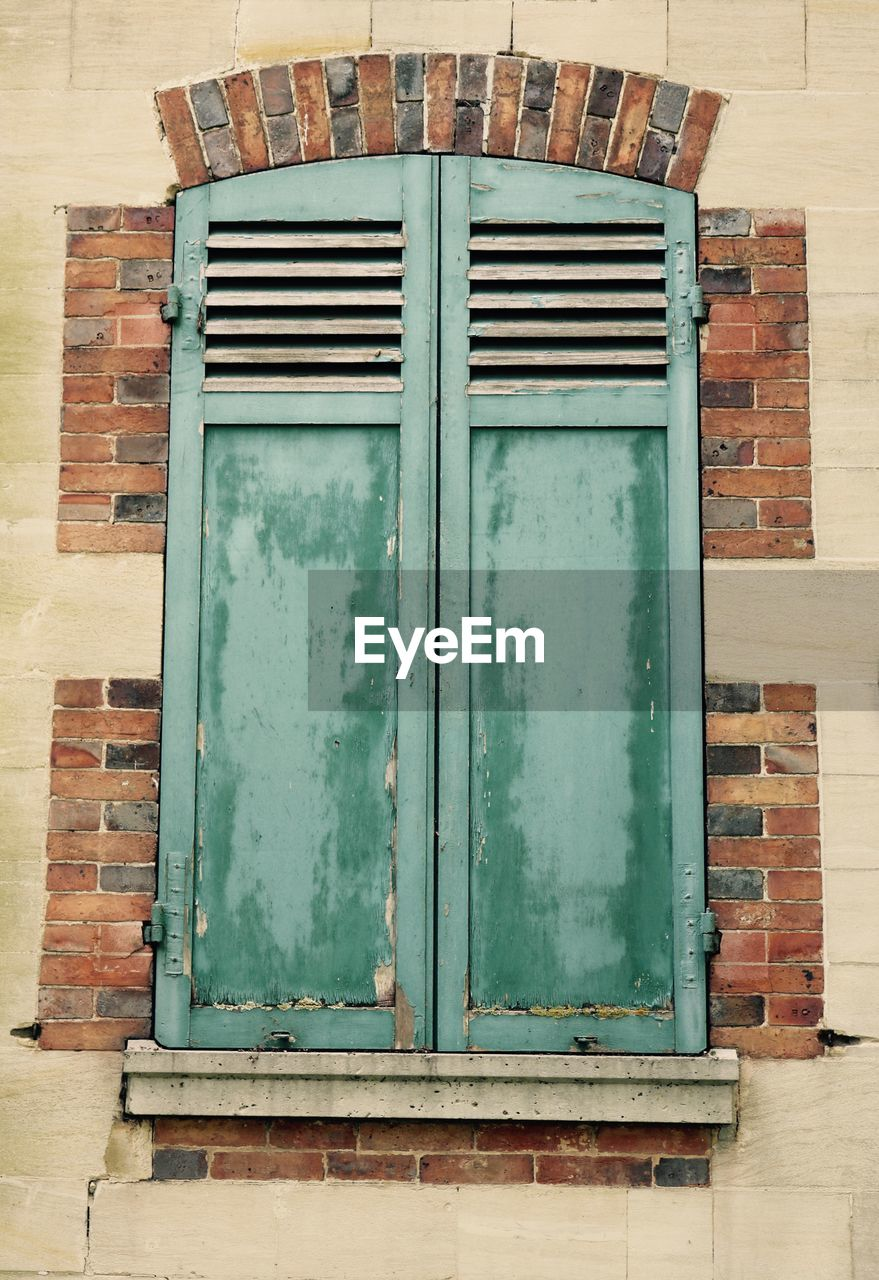 no people, door, day, built structure, architecture, wood - material, outdoors, brick wall, building exterior, green color, close-up