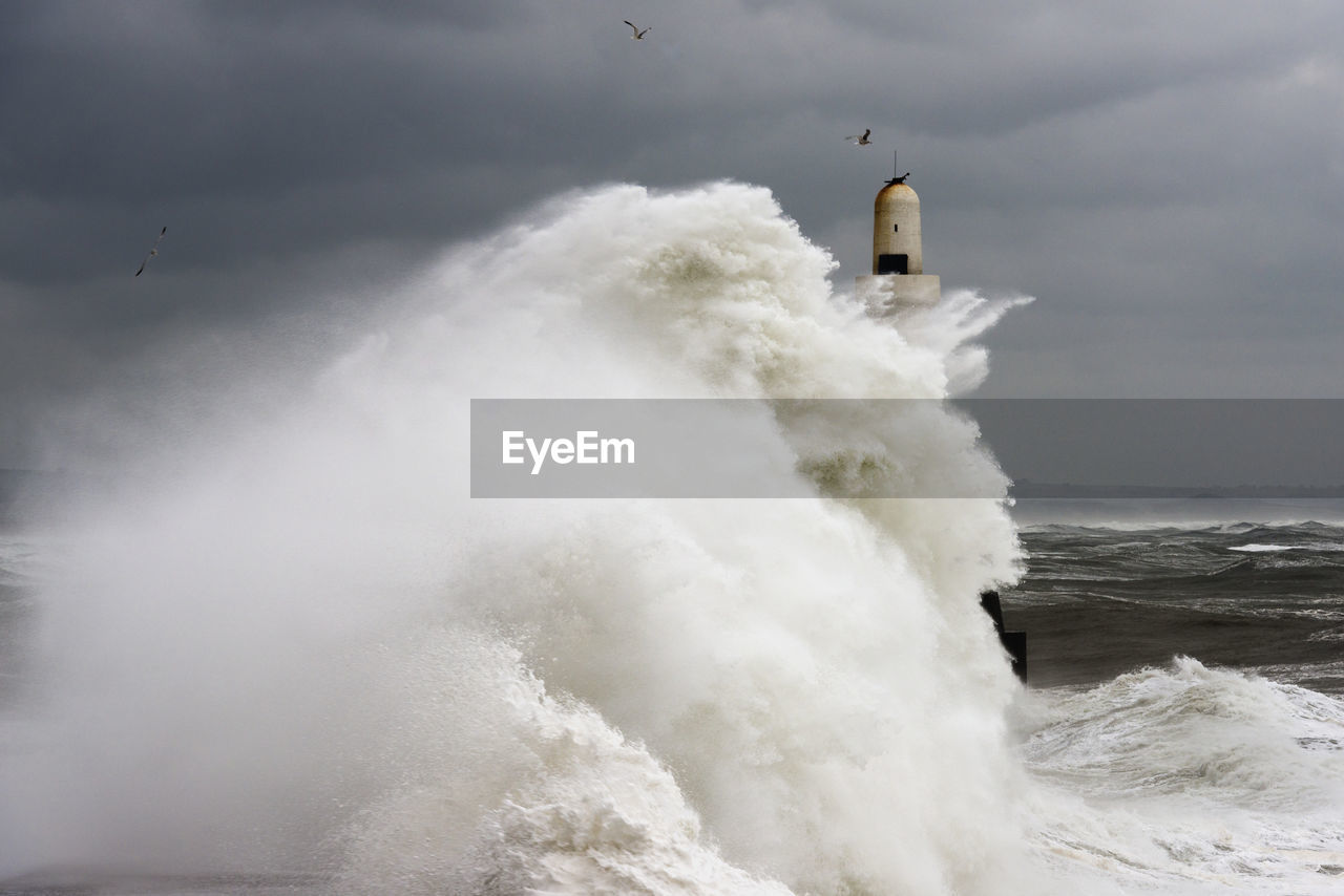 motion, water, sea, power in nature, sky, wave, nature, no people, cloud - sky, built structure, beauty in nature, power, architecture, tower, splashing, scenics - nature, travel, day, building exterior, lighthouse, outdoors, breaking, hitting, flowing water