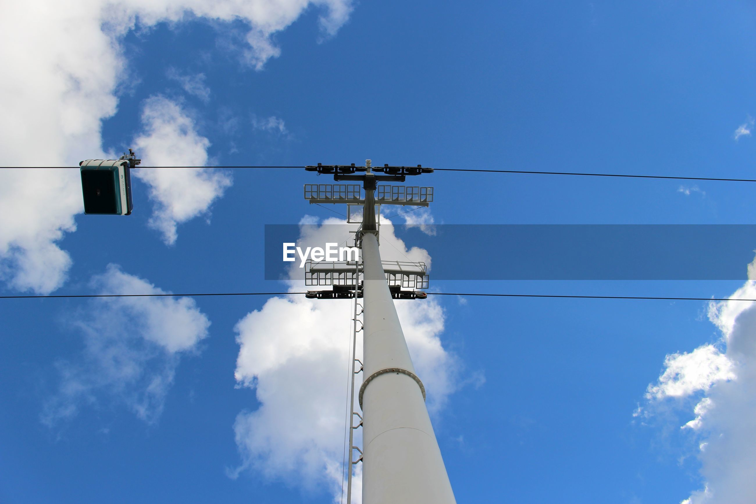 Low angle view of cable car pole against sky