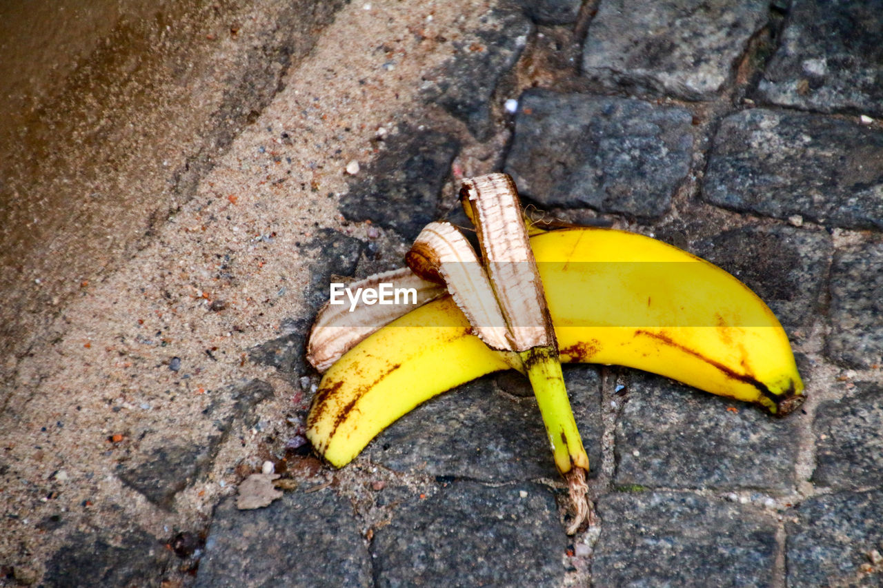 banana, banana peel, fruit, yellow, food and drink, danger, slippery, high angle view, day, risk, no people, outdoors, food, freshness, healthy eating, close-up