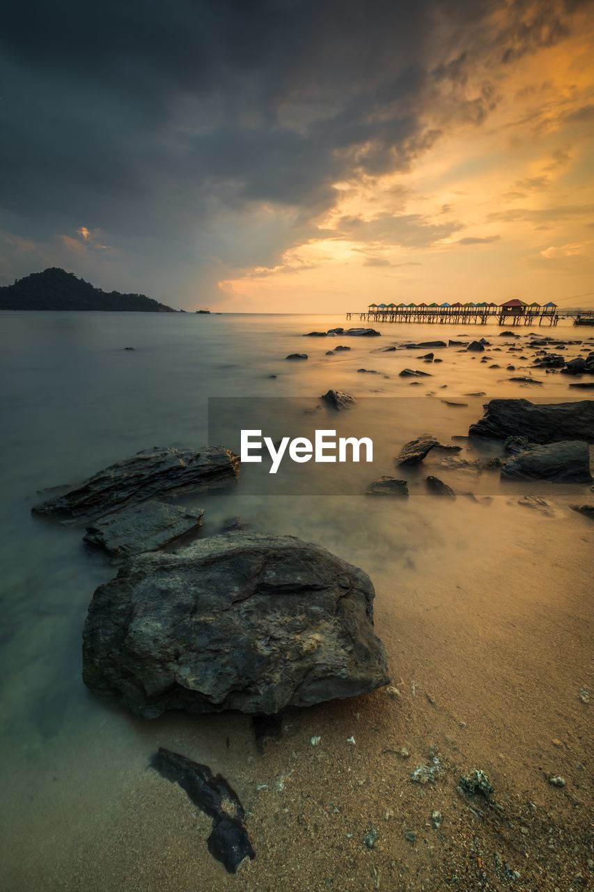sunset, sky, sea, water, cloud - sky, beauty in nature, scenics - nature, land, beach, rock, tranquil scene, nature, tranquility, rock - object, solid, no people, orange color, idyllic, non-urban scene, horizon over water, outdoors, marine