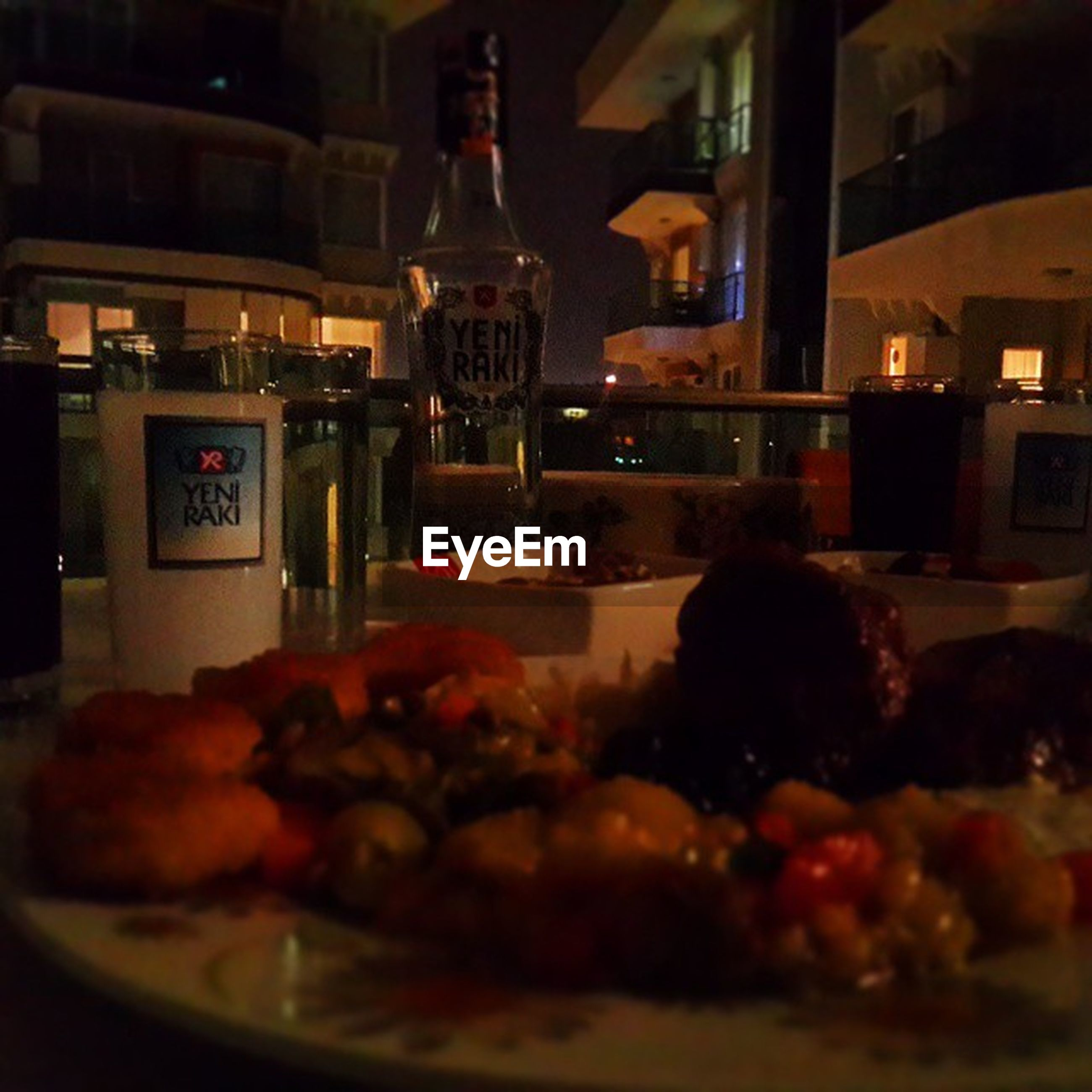 indoors, food and drink, food, illuminated, freshness, table, architecture, night, ready-to-eat, built structure, selective focus, restaurant, still life, unhealthy eating, text, indulgence, no people, sweet food, building exterior, close-up