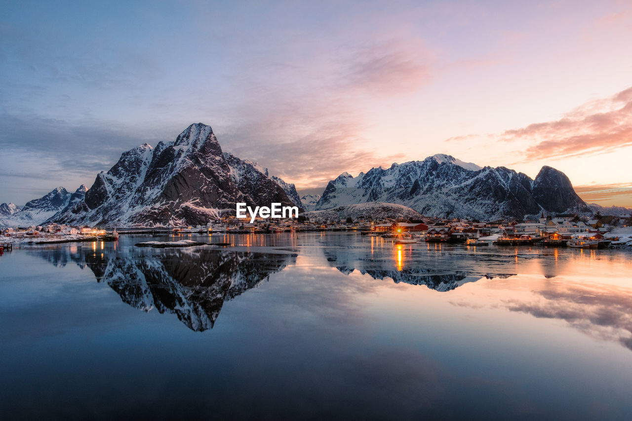 water, reflection, sky, cloud - sky, mountain, scenics - nature, tranquility, tranquil scene, beauty in nature, sunset, waterfront, lake, mountain range, nature, no people, idyllic, dusk, rock, outdoors