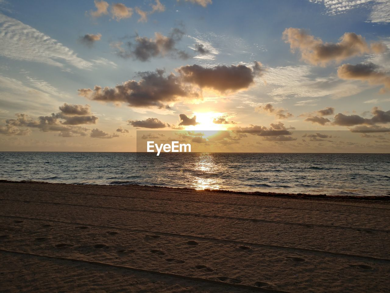 sky, water, sea, sunset, beauty in nature, scenics - nature, land, horizon over water, beach, tranquil scene, tranquility, horizon, cloud - sky, idyllic, sand, nature, sunlight, sun, outdoors, no people