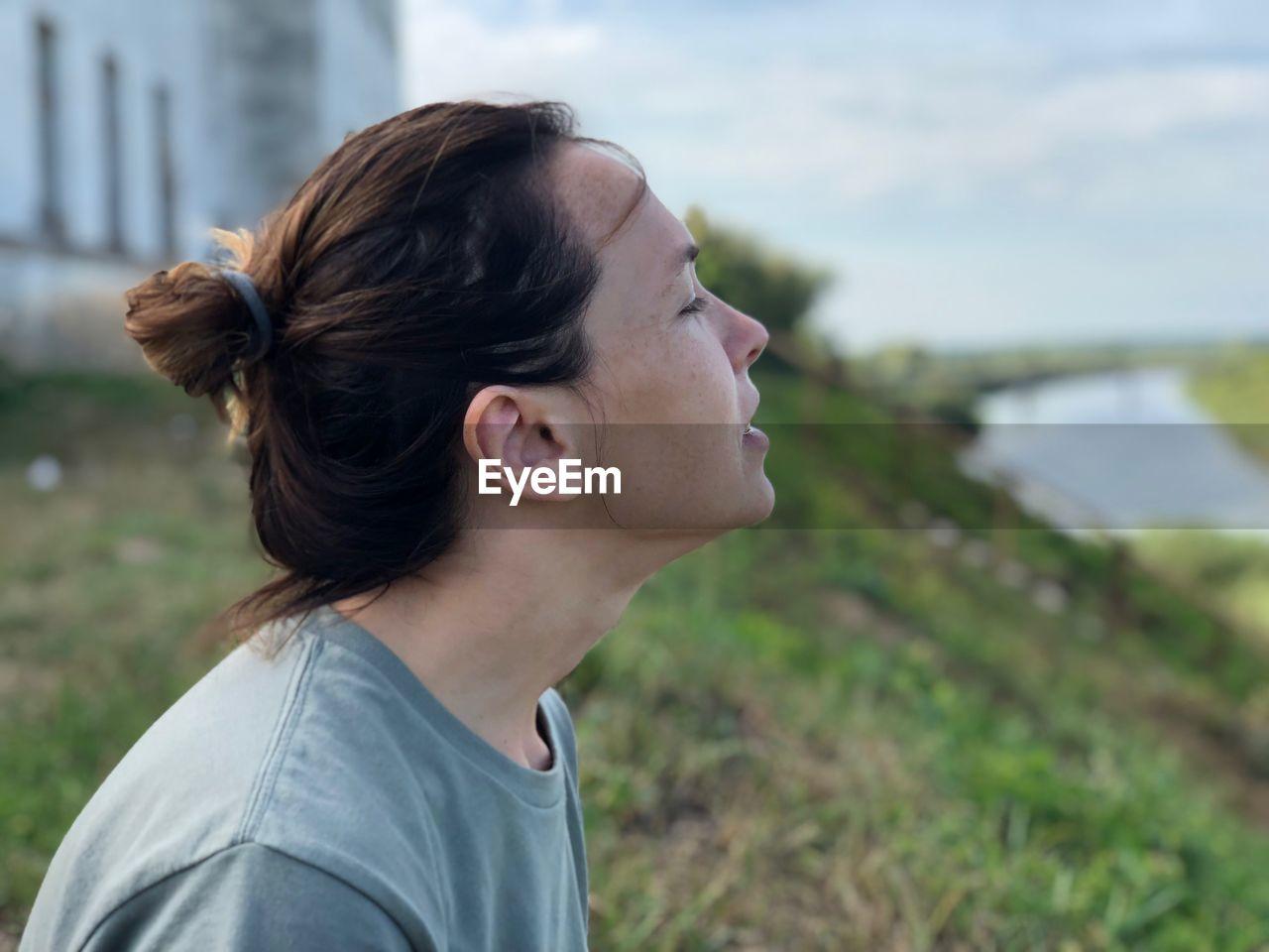 Woman Looking Away Against Sky