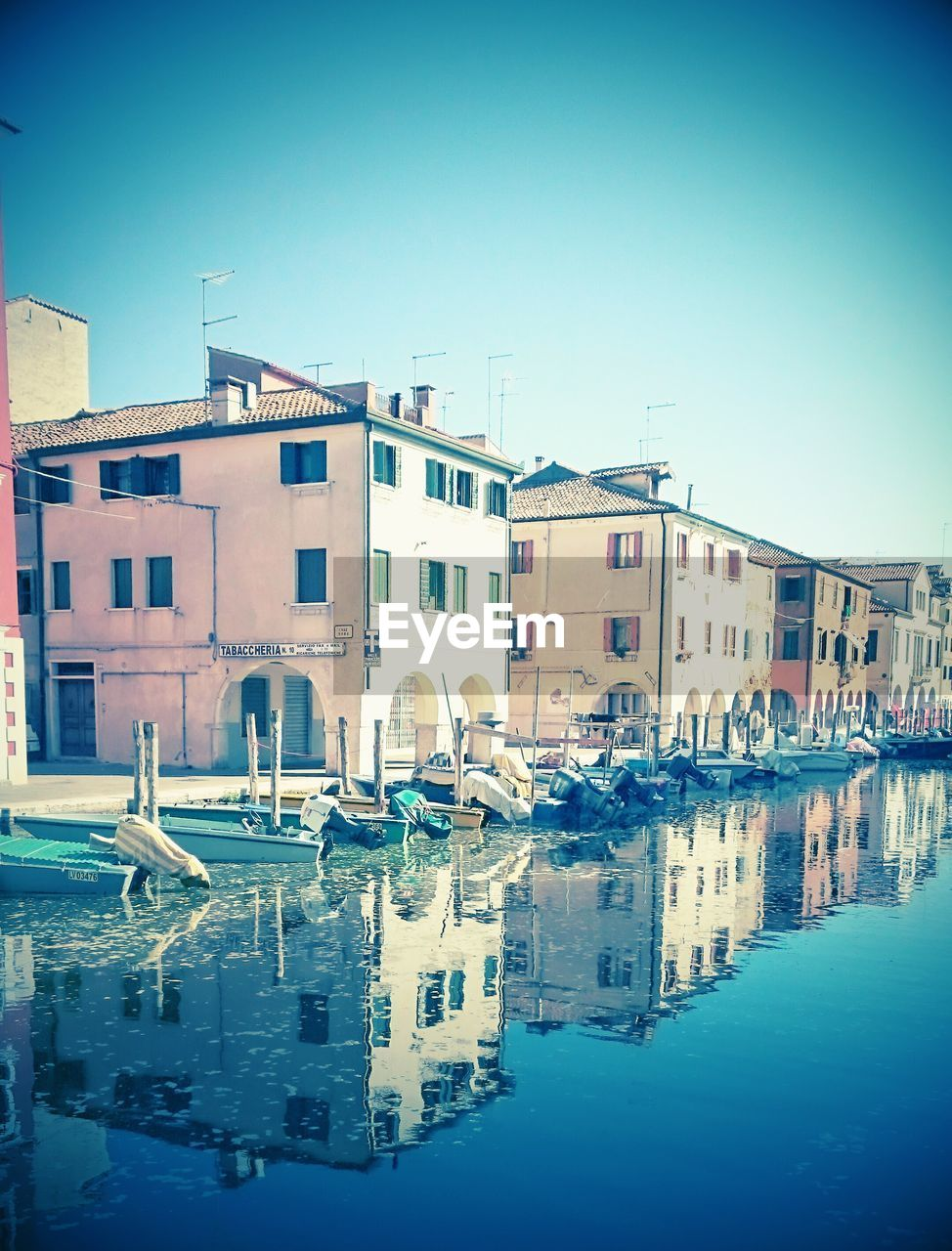 architecture, building exterior, built structure, water, waterfront, clear sky, residential building, outdoors, no people, day, blue, travel destinations, sky, nautical vessel, city, nature