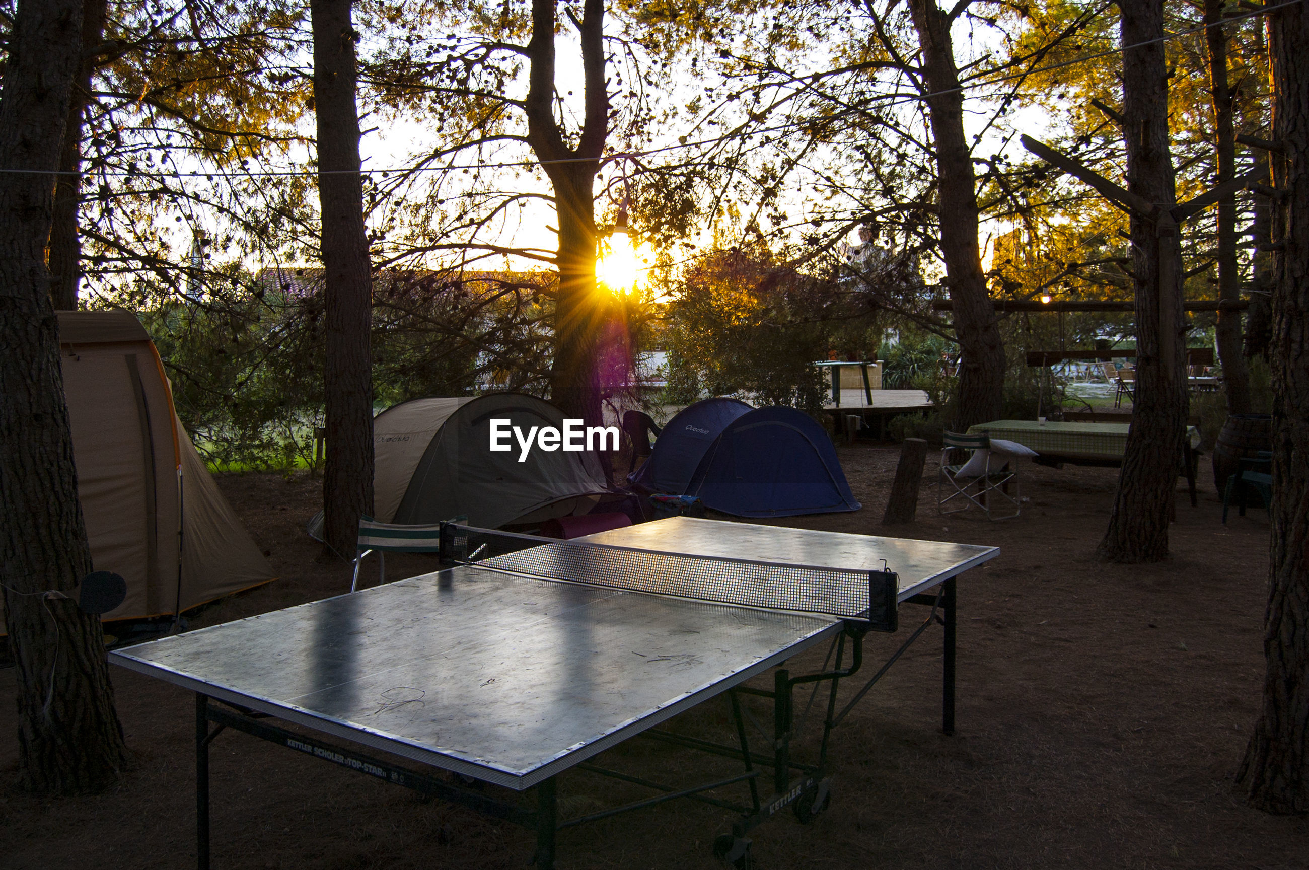 Camping site with table tennis table at sunset