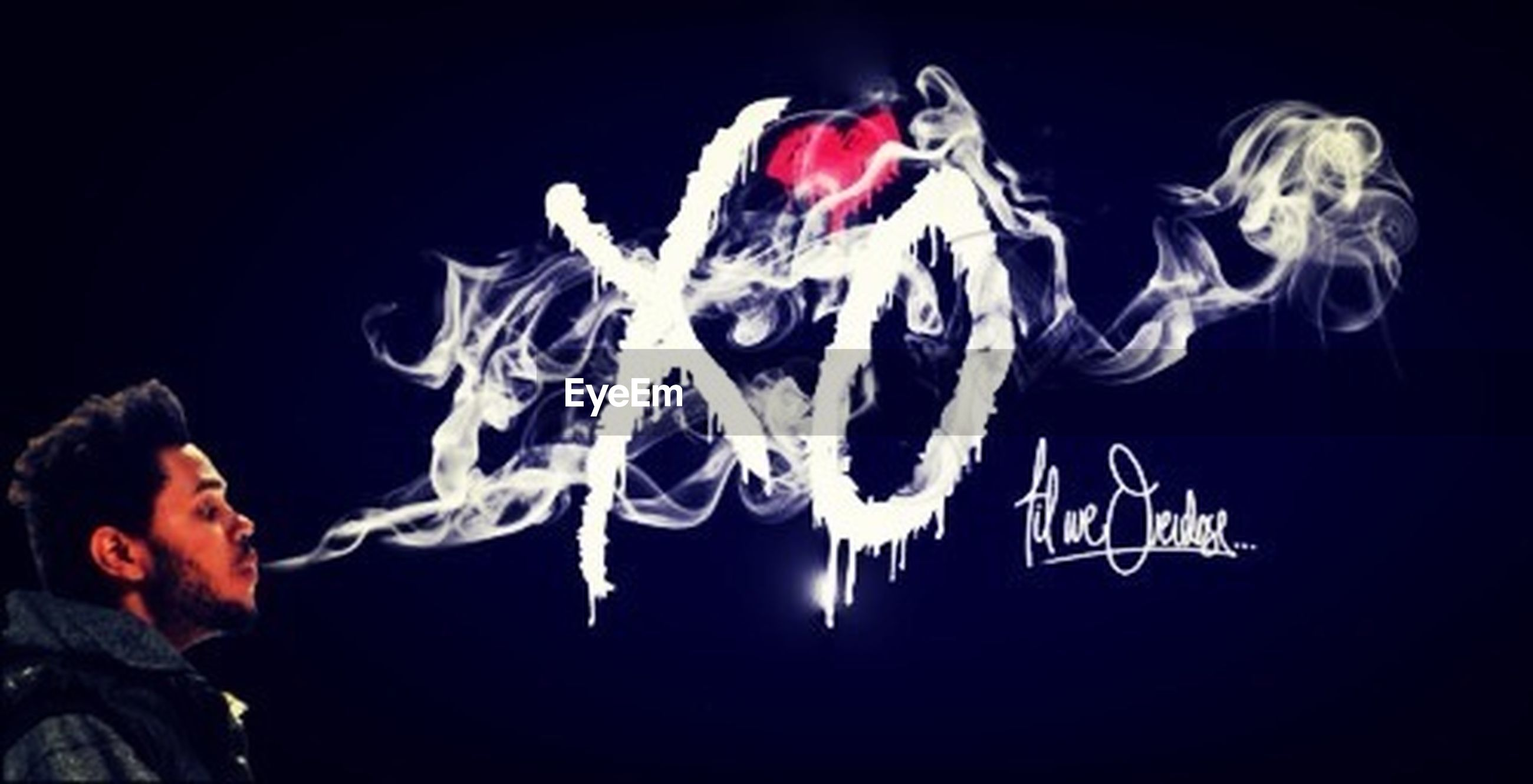 black background, studio shot, night, creativity, art and craft, art, copy space, red, celebration, indoors, close-up, dark, men, animal representation, holding, human representation, person, illuminated