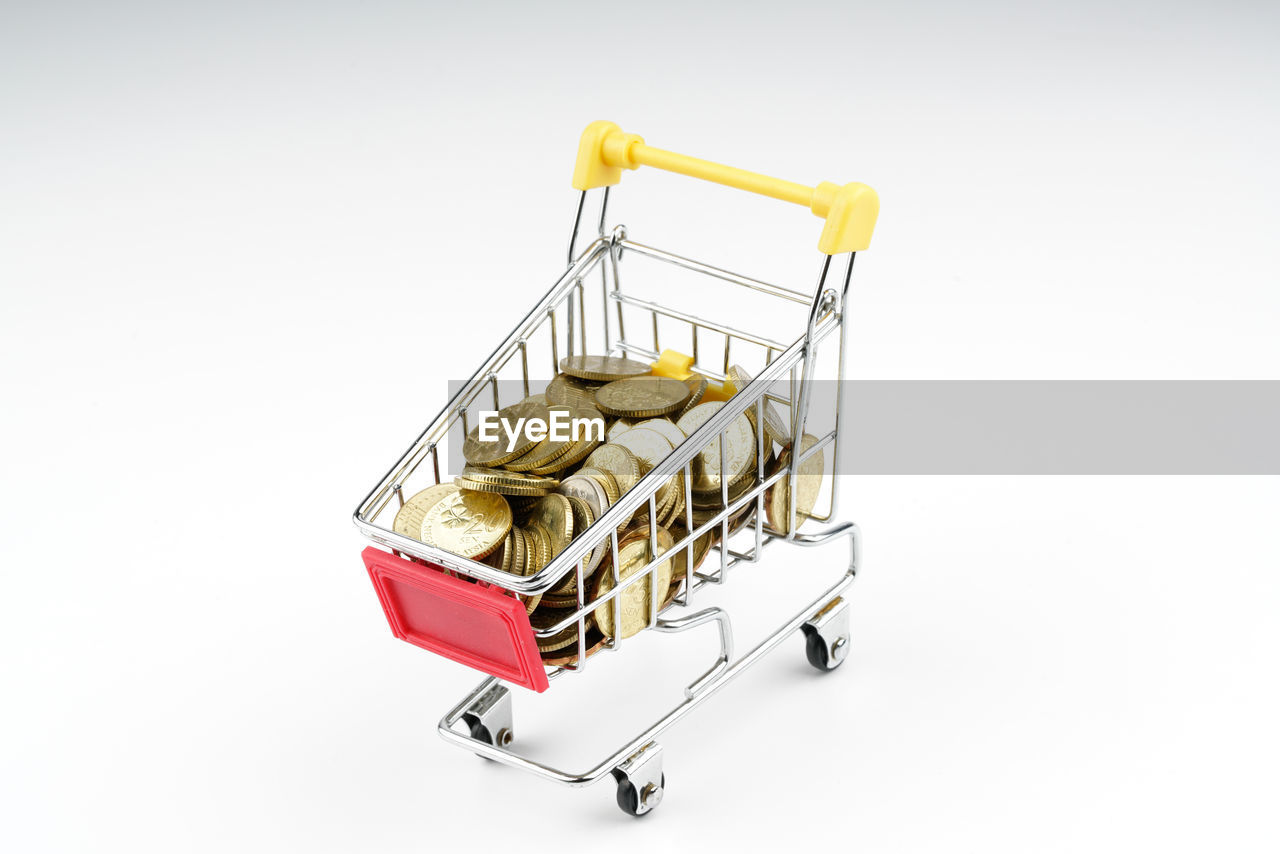 white background, studio shot, gold colored, consumerism, no people, yellow, retail, shopping cart, gold, close-up, supermarket
