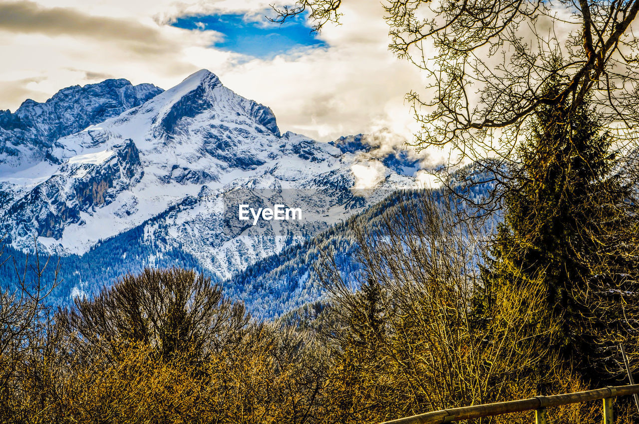 beauty in nature, mountain, sky, tree, plant, scenics - nature, cloud - sky, tranquility, tranquil scene, snow, no people, winter, cold temperature, nature, mountain range, non-urban scene, snowcapped mountain, day, environment, outdoors, mountain peak, formation