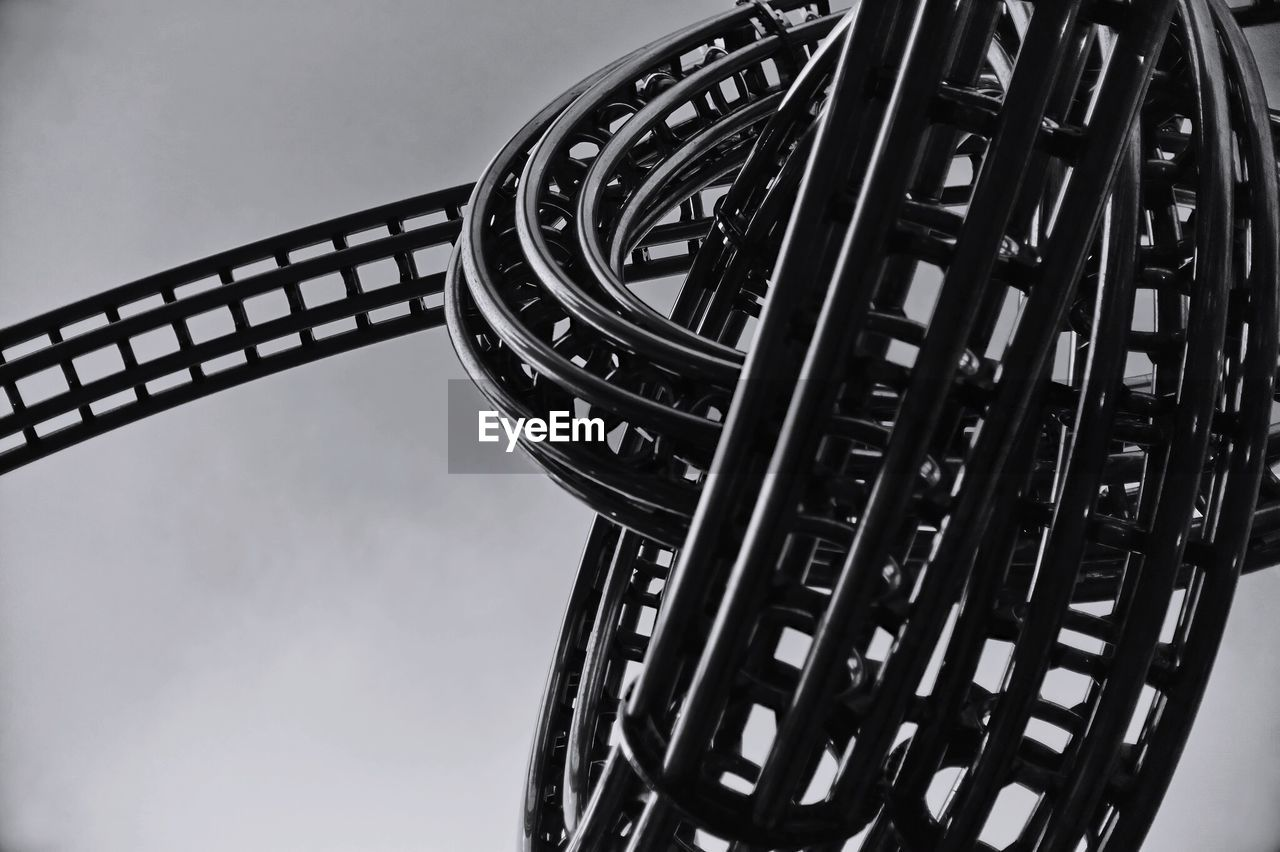 Low Angle View Of Roller Coaster Against Sky