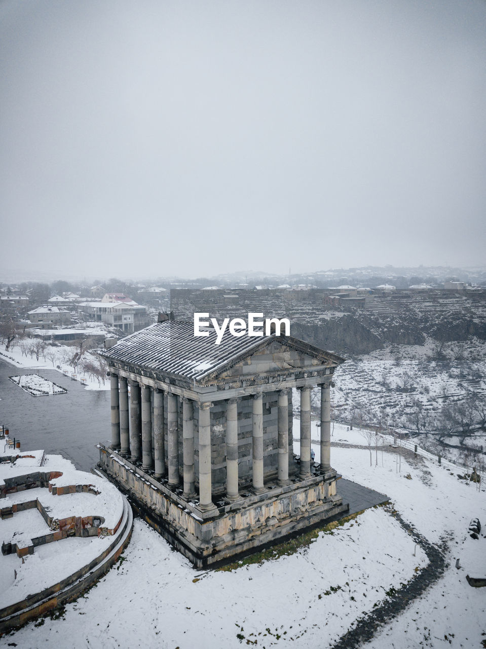 HIGH ANGLE VIEW OF SNOW COVERED BUILDINGS AGAINST CLEAR SKY