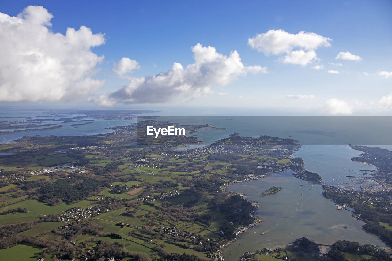 Aerial View Of Landscape And Sea Against Sky