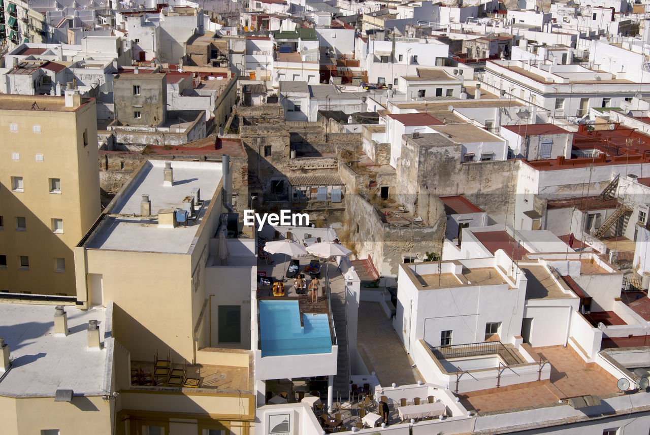 High angle view of buildings with private swimming pool in town