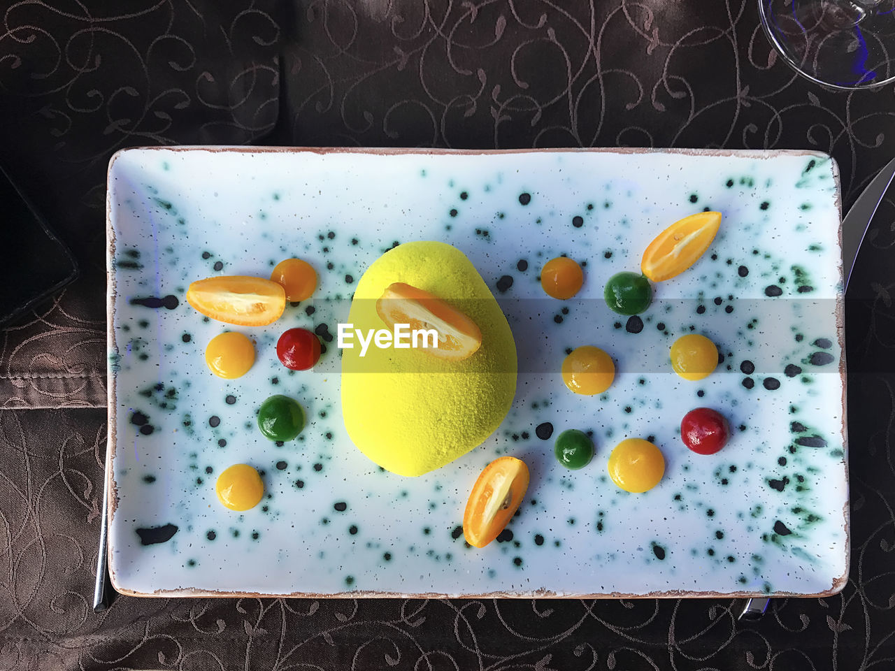 healthy eating, food, food and drink, directly above, freshness, indoors, wellbeing, no people, fruit, still life, vegetable, slice, close-up, pattern, high angle view, plate, ready-to-eat, table, root vegetable, household equipment, tray, breakfast, orange