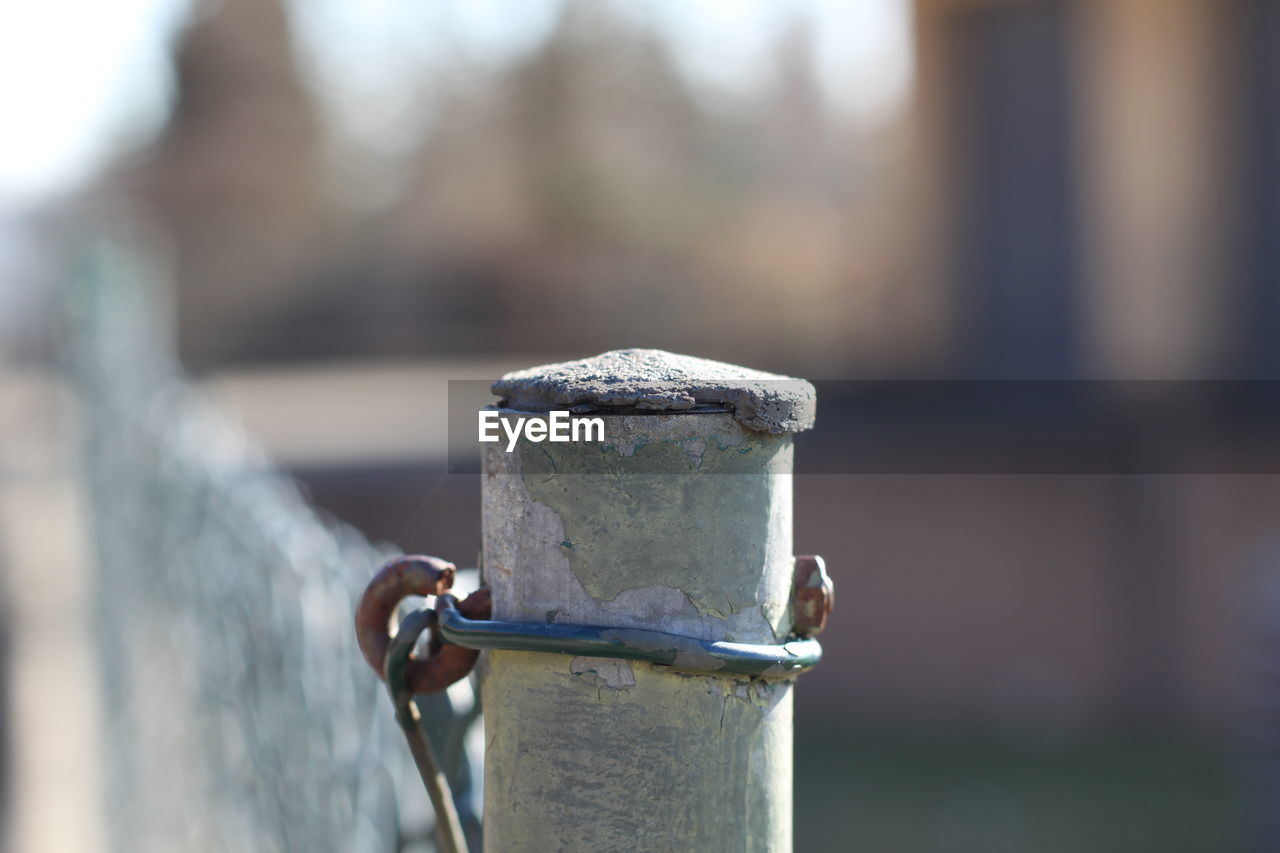 metal, focus on foreground, day, close-up, no people, outdoors, safety, nature, security, strength, selective focus, fence, barrier, boundary, pole, protection, silver colored, post, sunlight, rusty, steel, wooden post