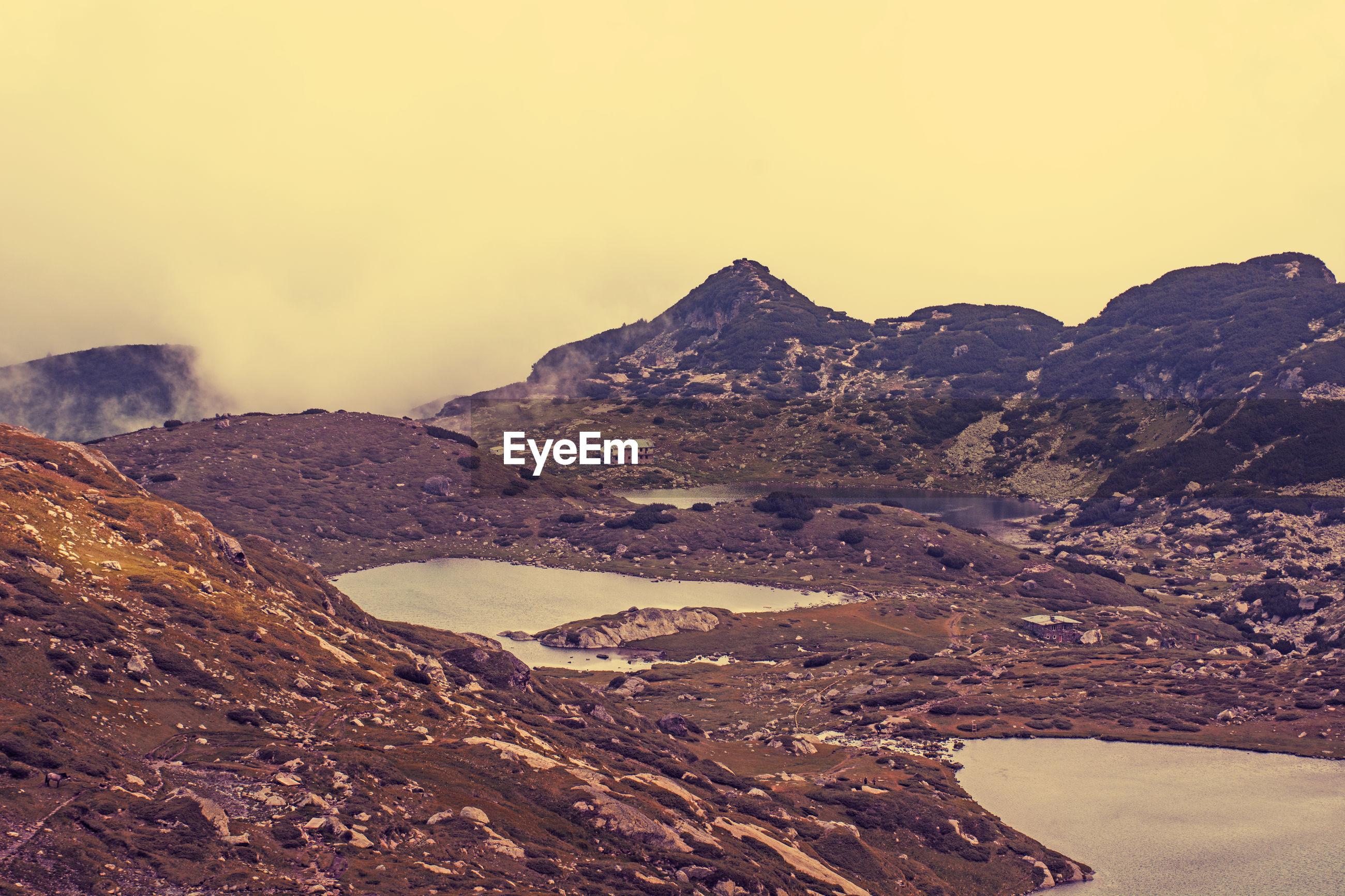 MOUNTAIN RANGE AGAINST SKY