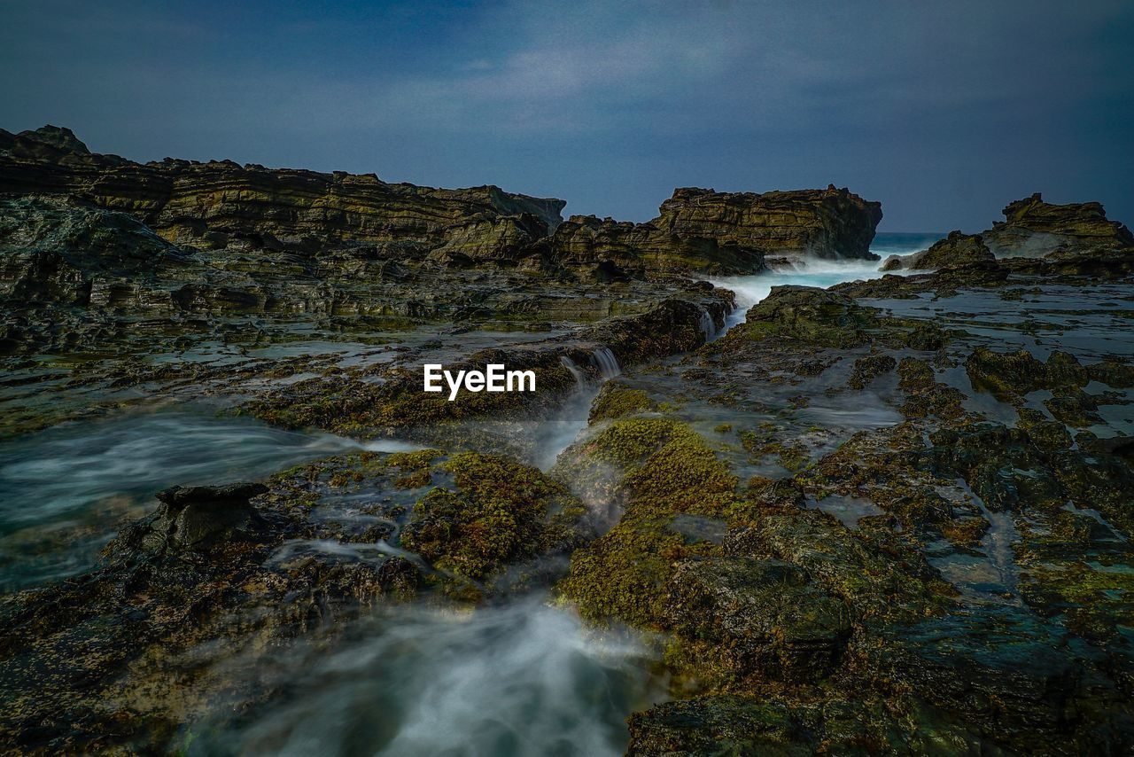 rock, rock - object, solid, beauty in nature, scenics - nature, water, sky, nature, motion, no people, rock formation, land, blurred motion, long exposure, day, tranquility, non-urban scene, sea, flowing water, outdoors, flowing, power in nature