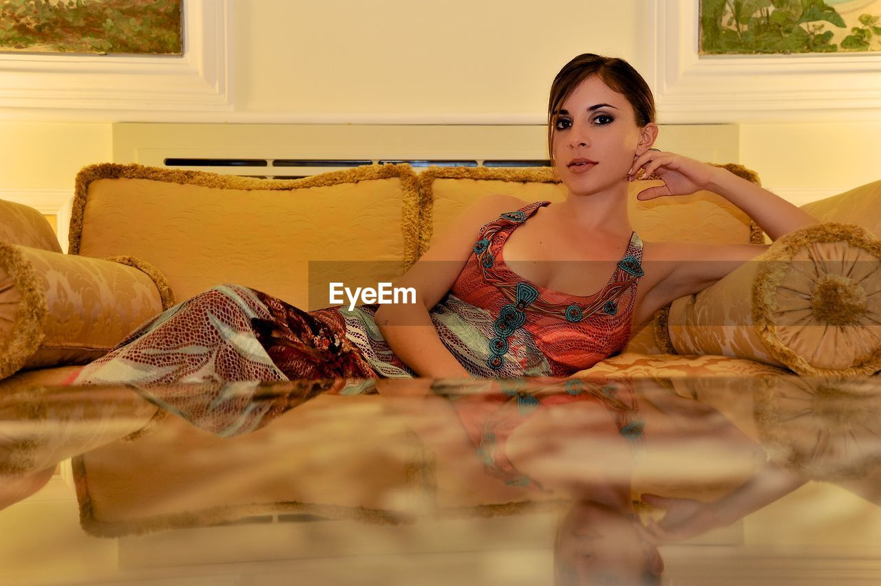 Portrait Of Beautiful Woman Relaxing On Sofa In Luxury Hotel