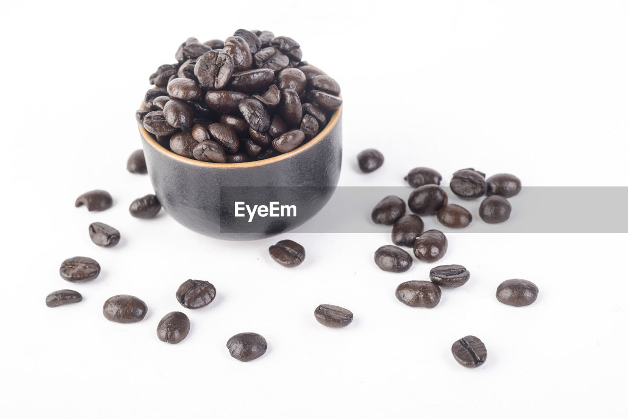 food and drink, food, coffee - drink, roasted coffee bean, still life, coffee, white background, indoors, freshness, no people, large group of objects, black color, high angle view, studio shot, brown, close-up, coffee bean, raw coffee bean, cup, healthy eating, caffeine