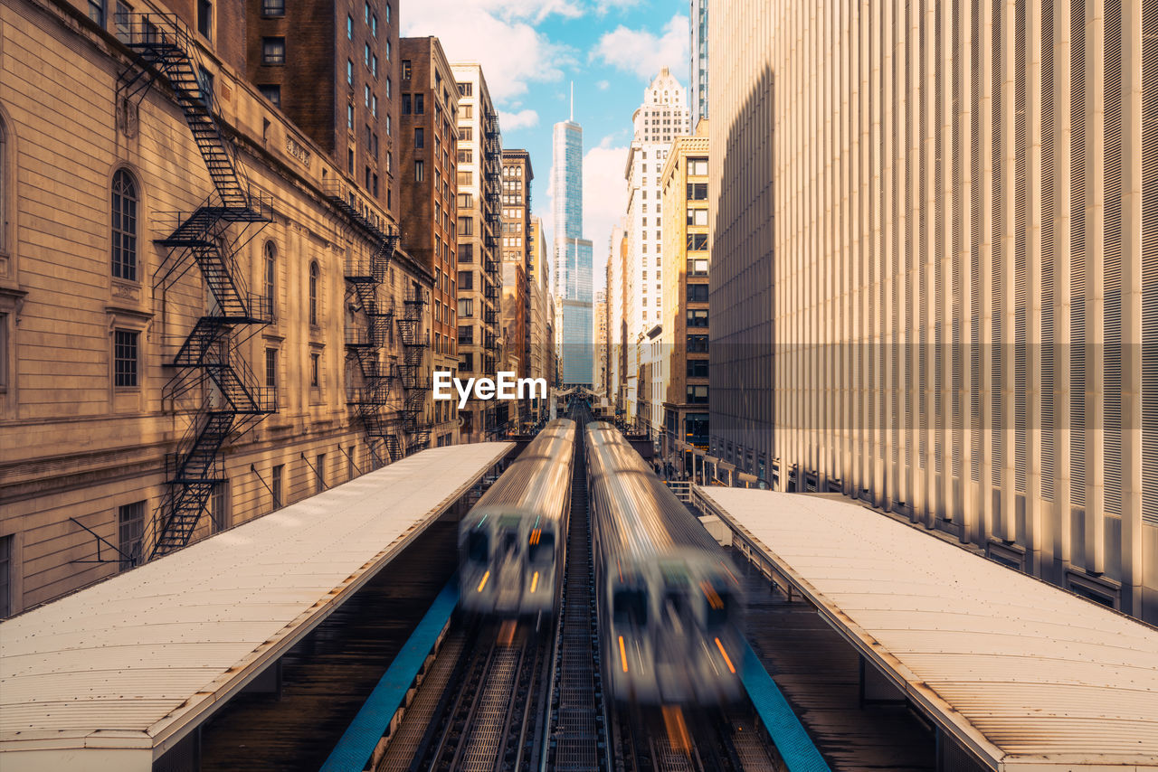 architecture, built structure, building exterior, city, building, transportation, sky, office building exterior, nature, day, skyscraper, cloud - sky, motion, bridge, diminishing perspective, blurred motion, connection, outdoors, bridge - man made structure, tower, no people, modern, financial district