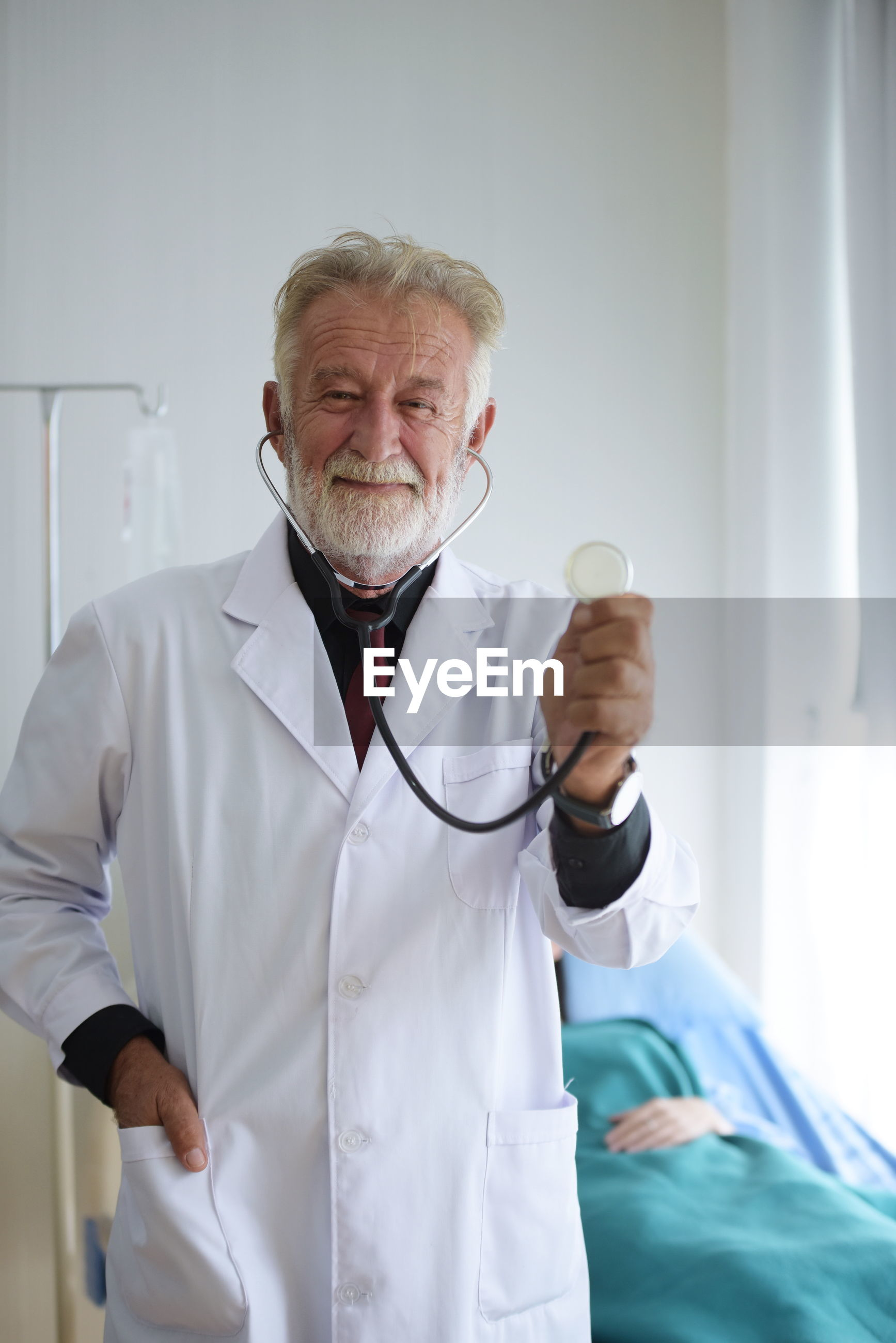 Portrait of doctor holding stethoscope at hospital