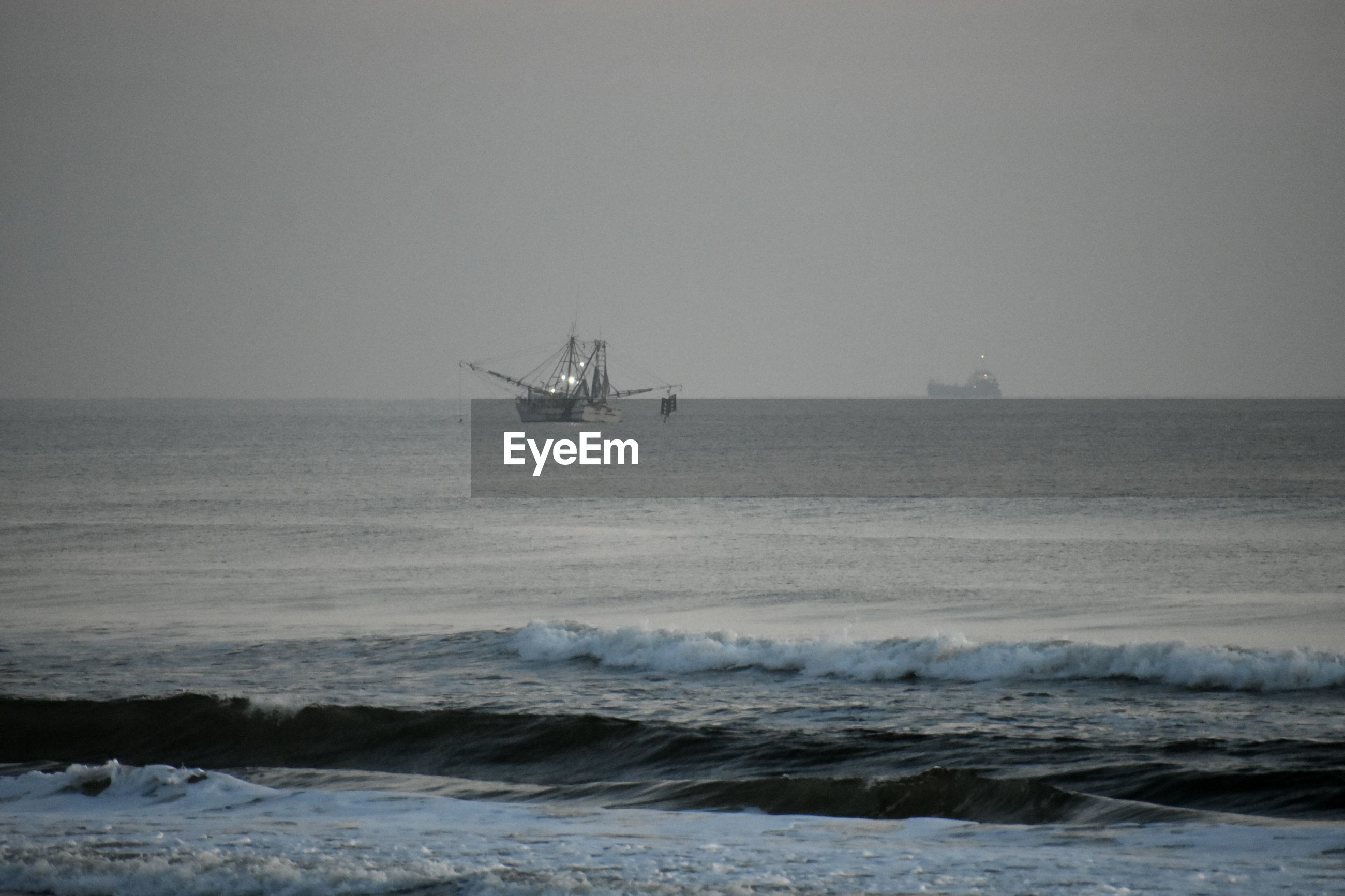 SHIP IN SEA AGAINST CLEAR SKY