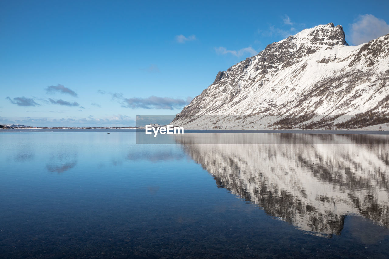 Scenic View Of Mountain Reflected In Lake Against Sky