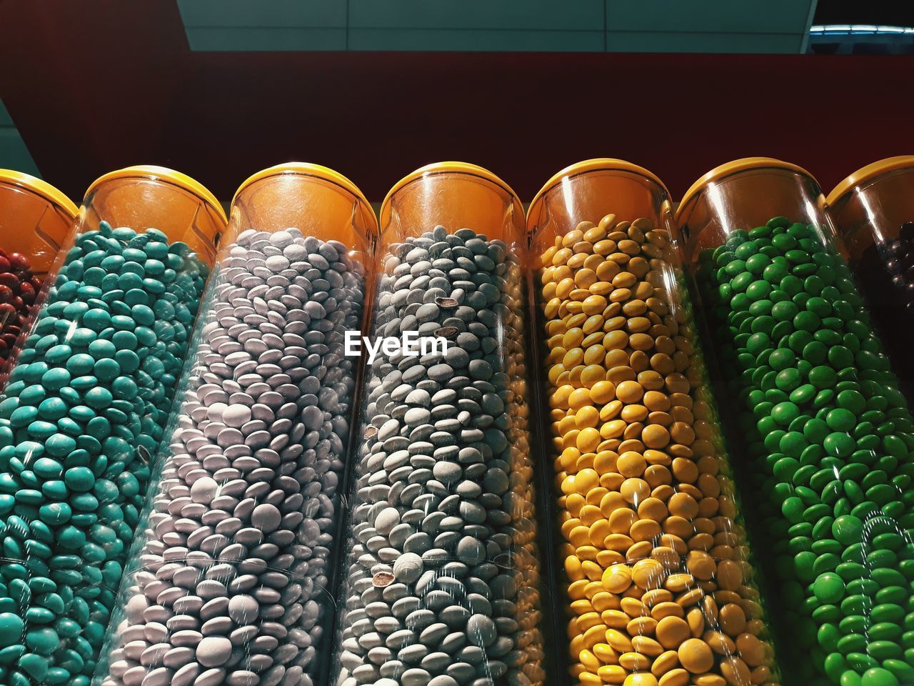 food and drink, food, still life, no people, large group of objects, indoors, side by side, freshness, vegetable, container, abundance, green color, multi colored, close-up, order, variation, choice, in a row, arrangement, for sale, retail display, sweetcorn, temptation