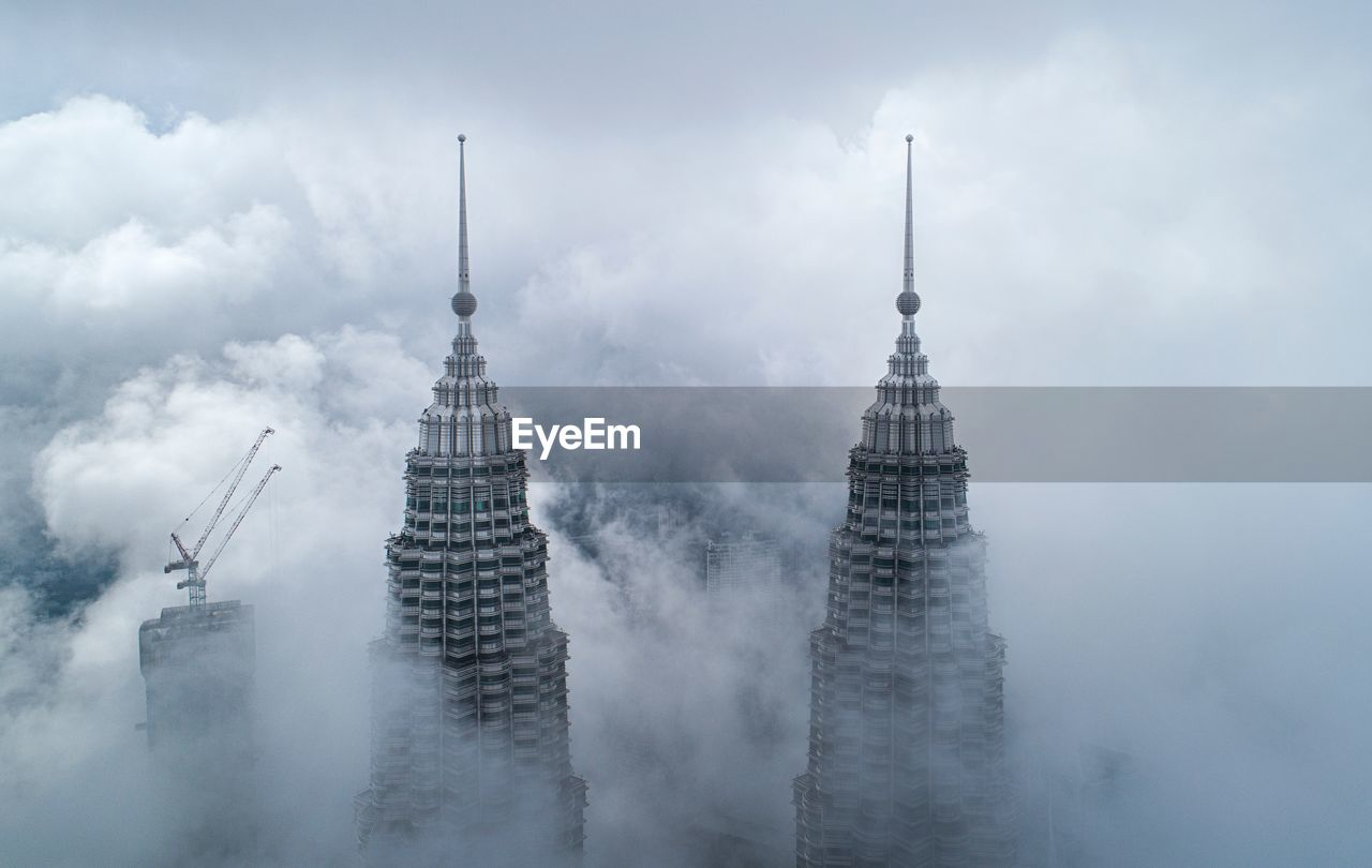 Drone shot of petronas towers in foggy weather